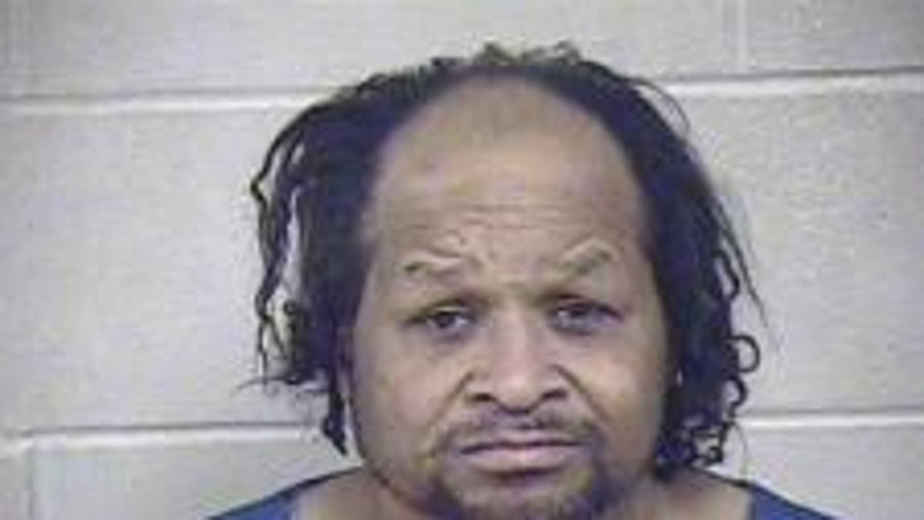 Larry J Oates, 55, is accused of hitting his mother with a skillet and choking her, officials said.