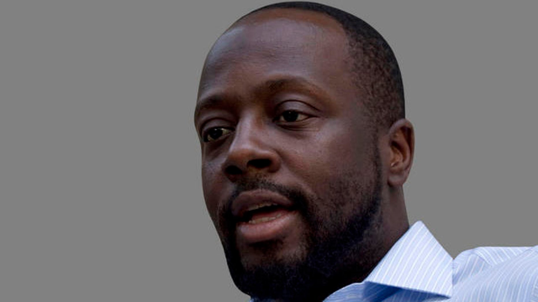 Haiti's presidential candidate and hip hop singer Wyclef Jean, center, speaks during an interview with The Associated Press in Croix de Bouquets, Haiti, Wednesday, Aug. 18, 2010. Jean says he has received death threats, which is why he is in seclusion until the electoral list is released. (AP Photo/Ramon Espinosa)