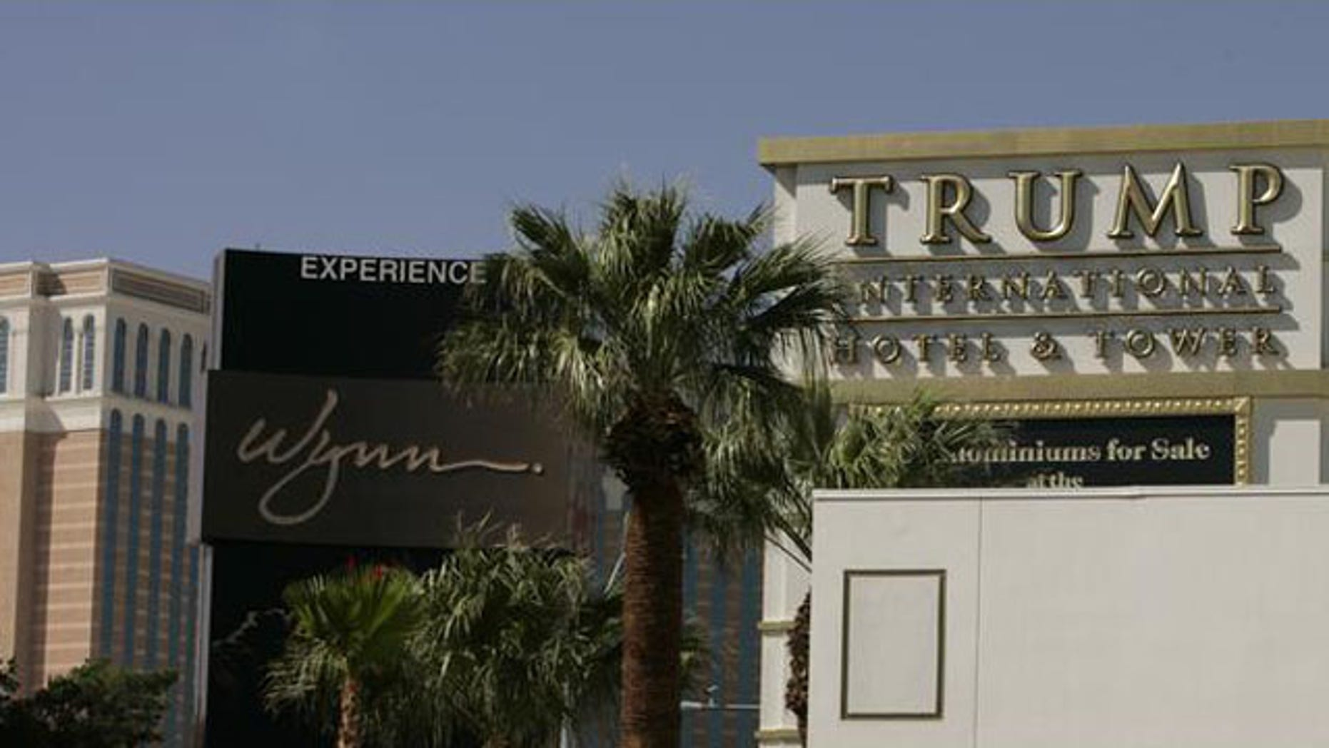 Shown here are the Venetian Hotel, Wynn Las Vegas Resort and a sign advertising the Trump International Hotel and Tower in Las Vegas. (AP Photo)