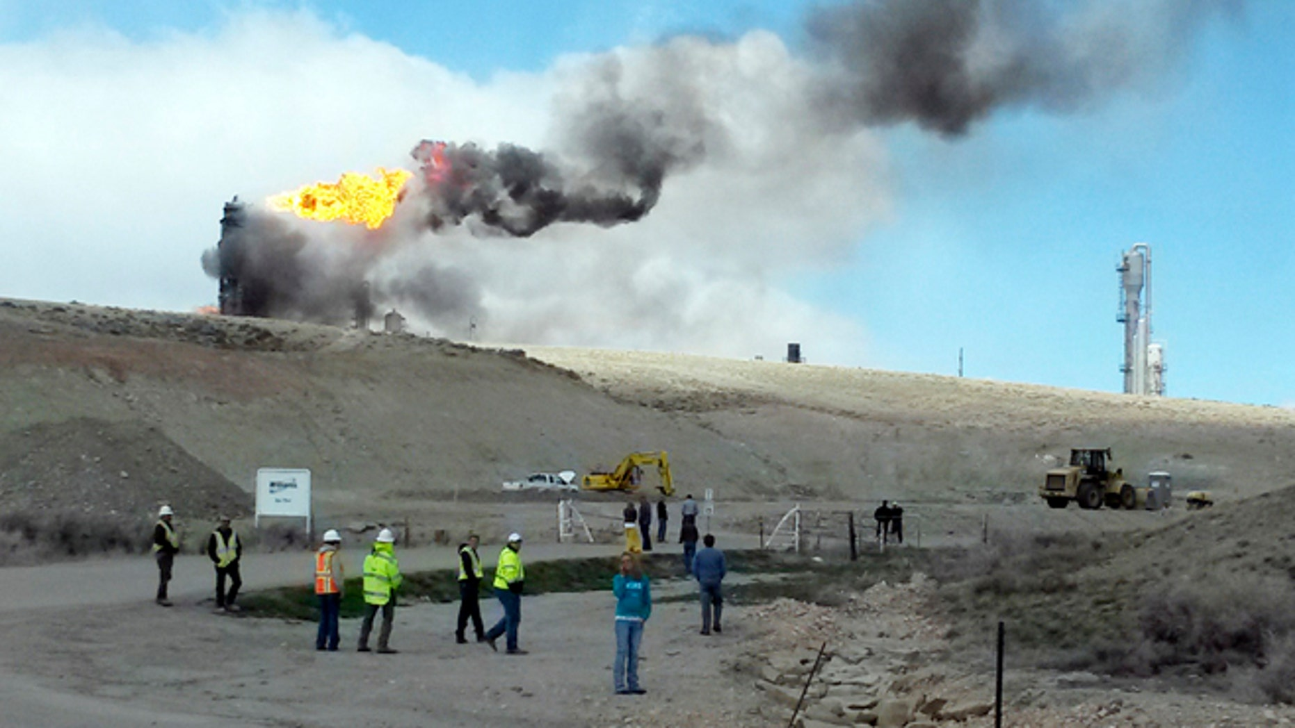 April 23: This image shows officials at the site of an explosion and fire at a natural gas processing facility and major national pipeline hub in Opal, Wyo.