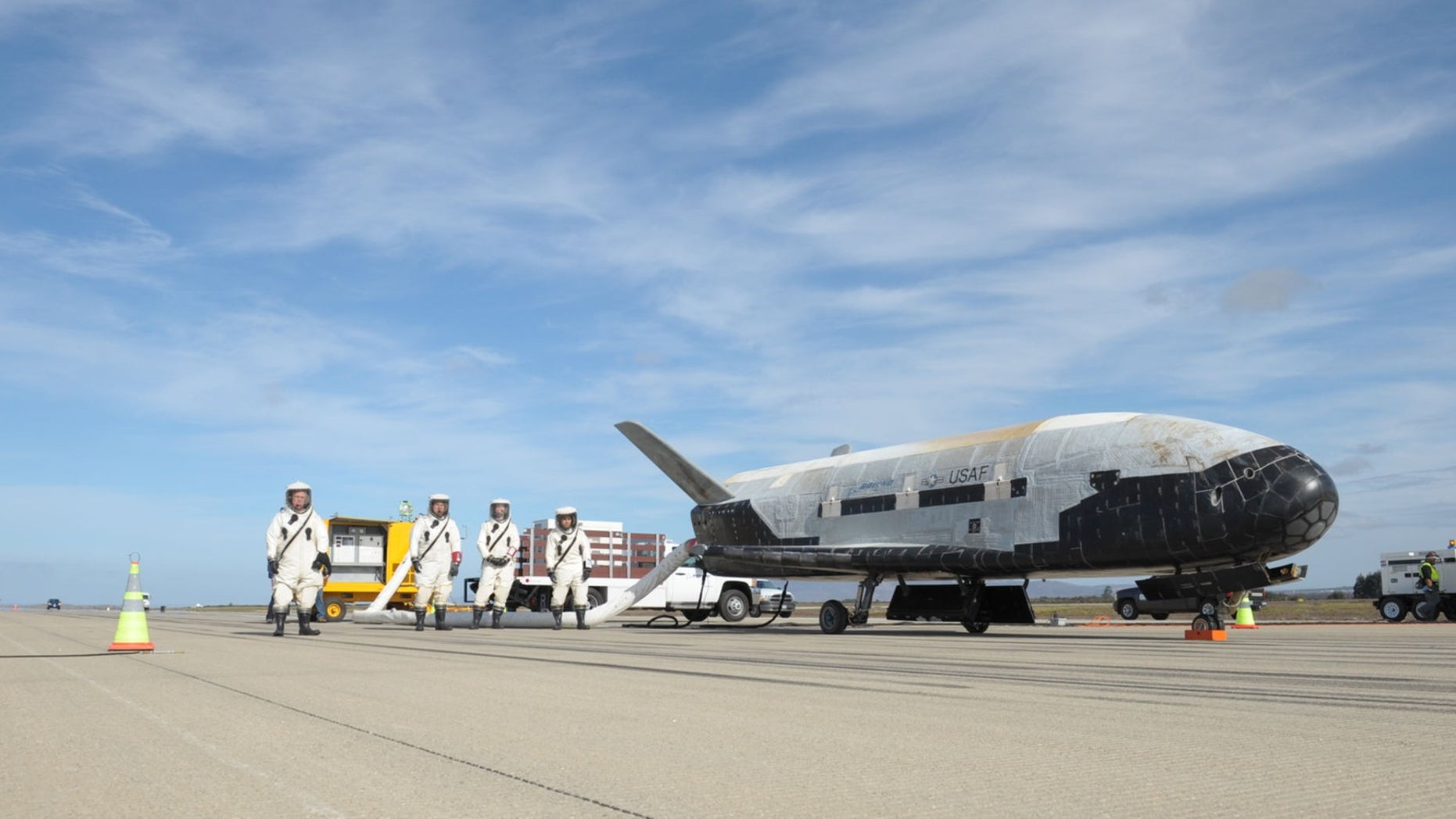 One of the U.S. Air Force's robotic X-37B space planes is seen on the runway after landing itself following a classified mission. The fifth X-37B mission, called Orbital Test Vehicle 5, will launch Sept. 7, 2017, from Florida's Cape Canaveral Air Force Station atop an Atlas V rocket.