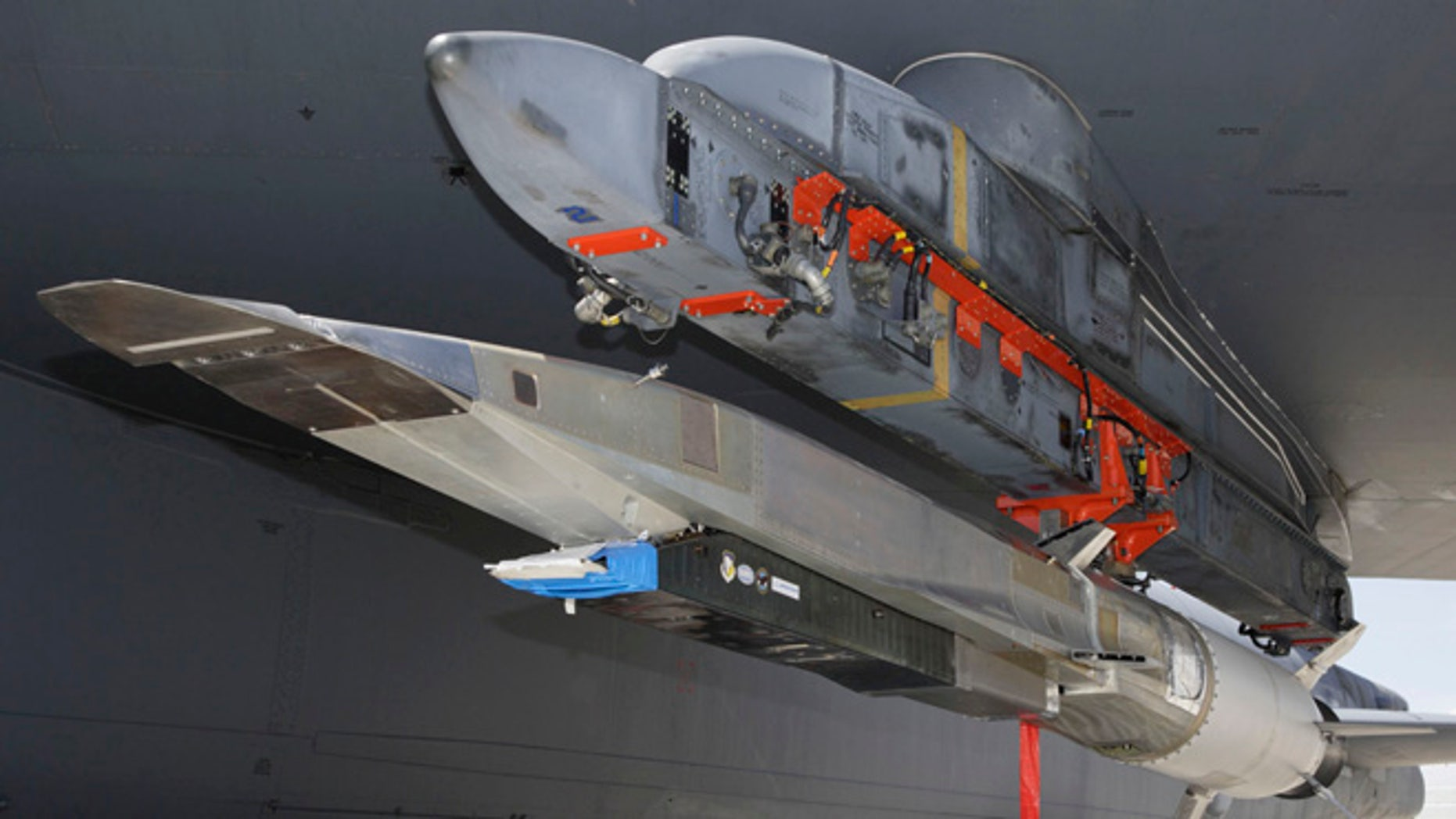 An X-51A WaveRider hypersonic flight test vehicle is uploaded to an Air Force Flight Test Center B-52 for fit testing at Edwards Air Force Base. Four scramjet-powered Waveriders were built for the Air Force. The Los Angeles Times says the unmanned X-51 WaveRider is expected to reach Mach 6 _ or about 3,600 mph _ Tuesday, Aug. 14, 2012, when it's dropped by a B-52 bomber and takes flight off the Southern California coast near Point Mugu.