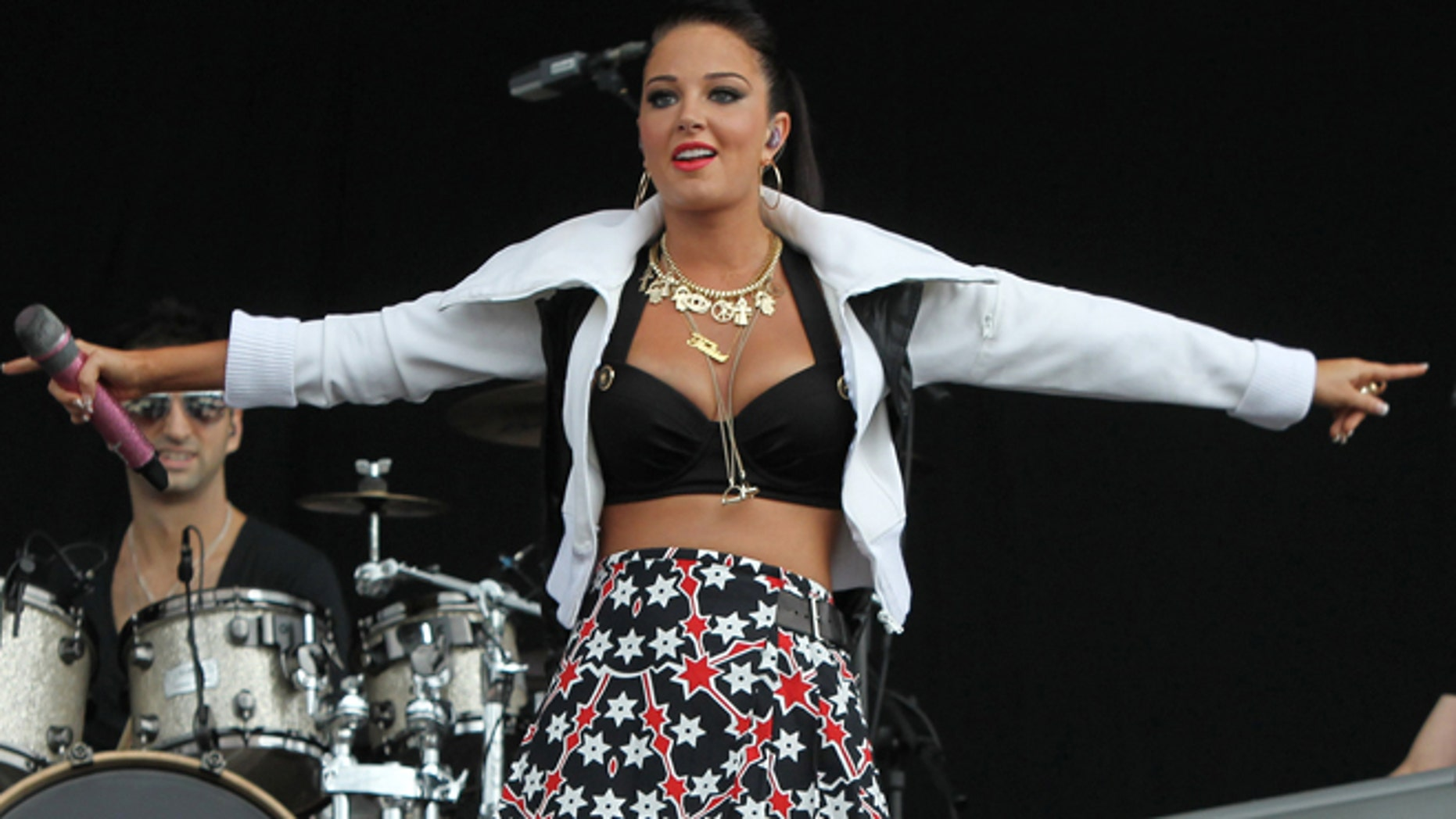 A Saturday, July 7, 2012 photo from files showing British singer Tulisa Contostavlos performing on stage at the 2012 Wireless Music Festival in Hyde Park, central London.