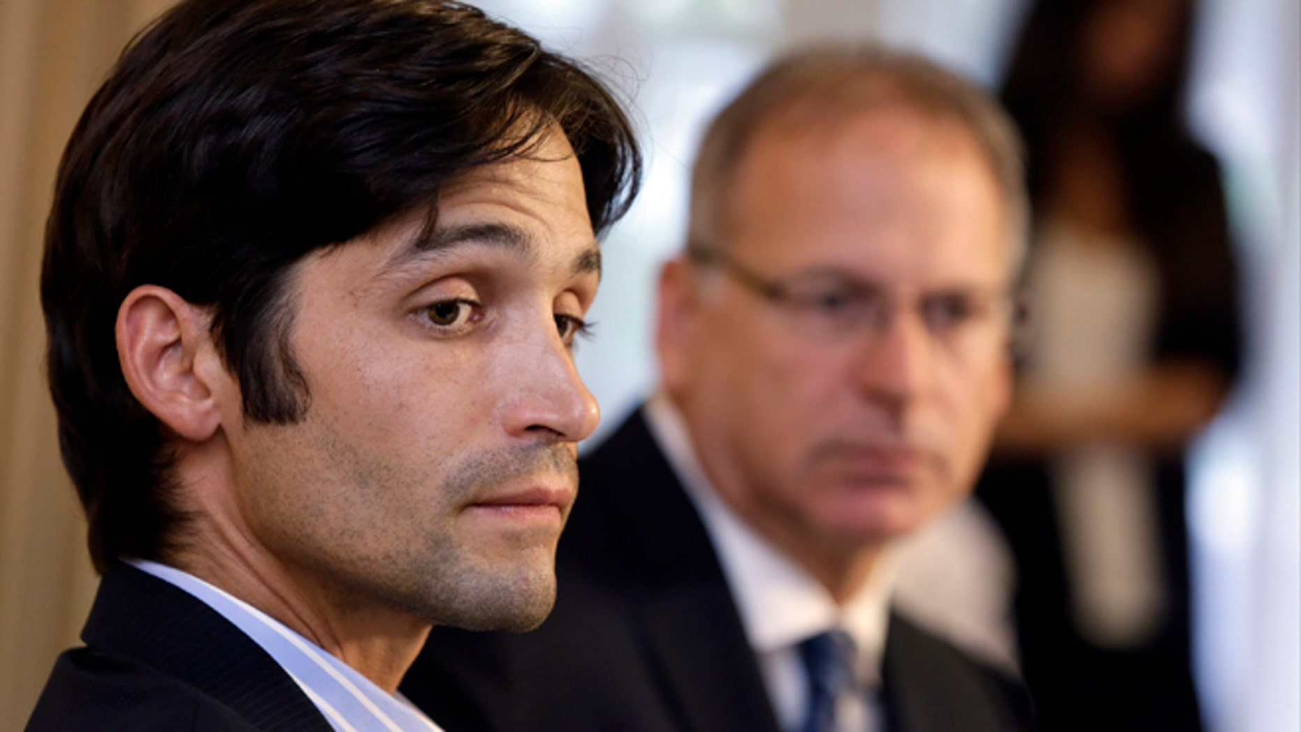 April 17, 2014: Plaintiff Michael Egan, left, with his attorney, Jeff Herman, take questions from the media during a news conference in Beverly Hills, Calif.
