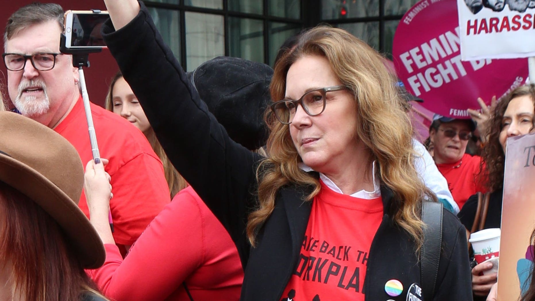 "Elizabeth Perkins joined a Me Too protest and held up a sign that said, ""James Woods #MeToo."""