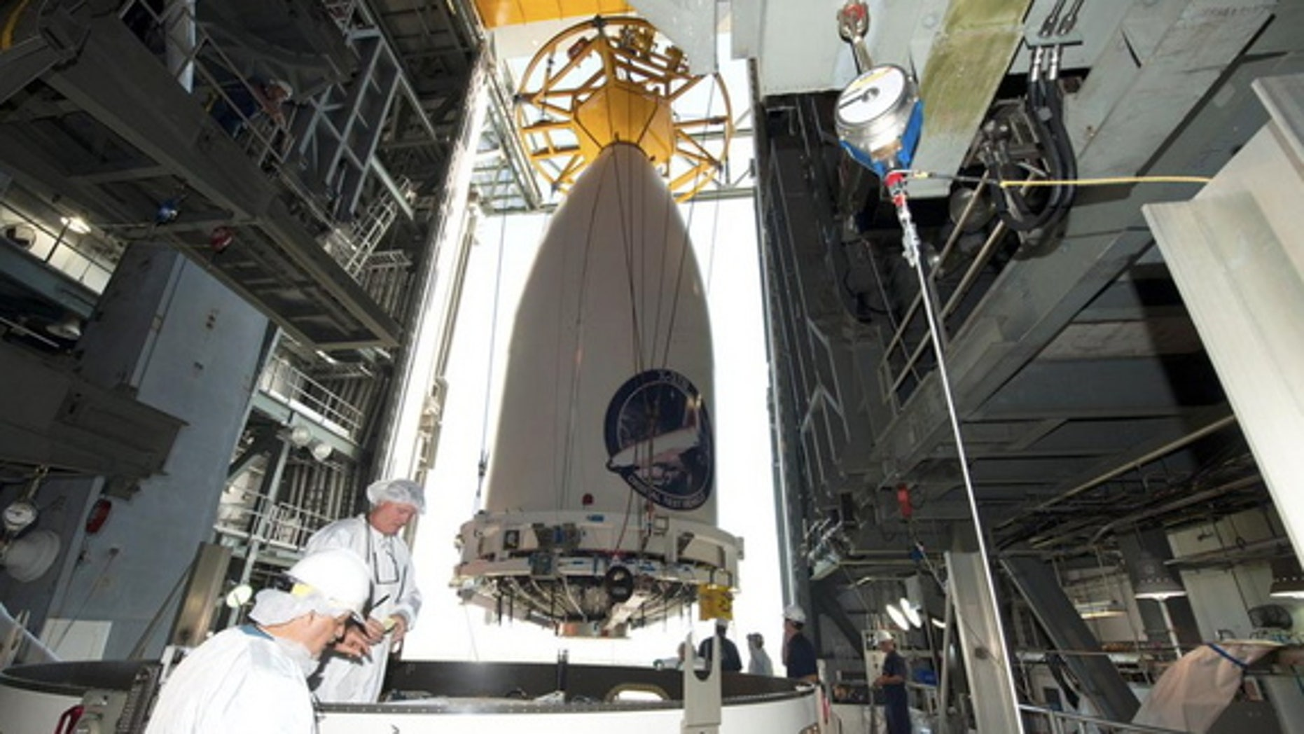 The Air Force's robotic X-37B space plane, encapsulated in its fairing, being readied for attachment to its Atlas V rocket ahead of a planned May 20, 2015 launch.