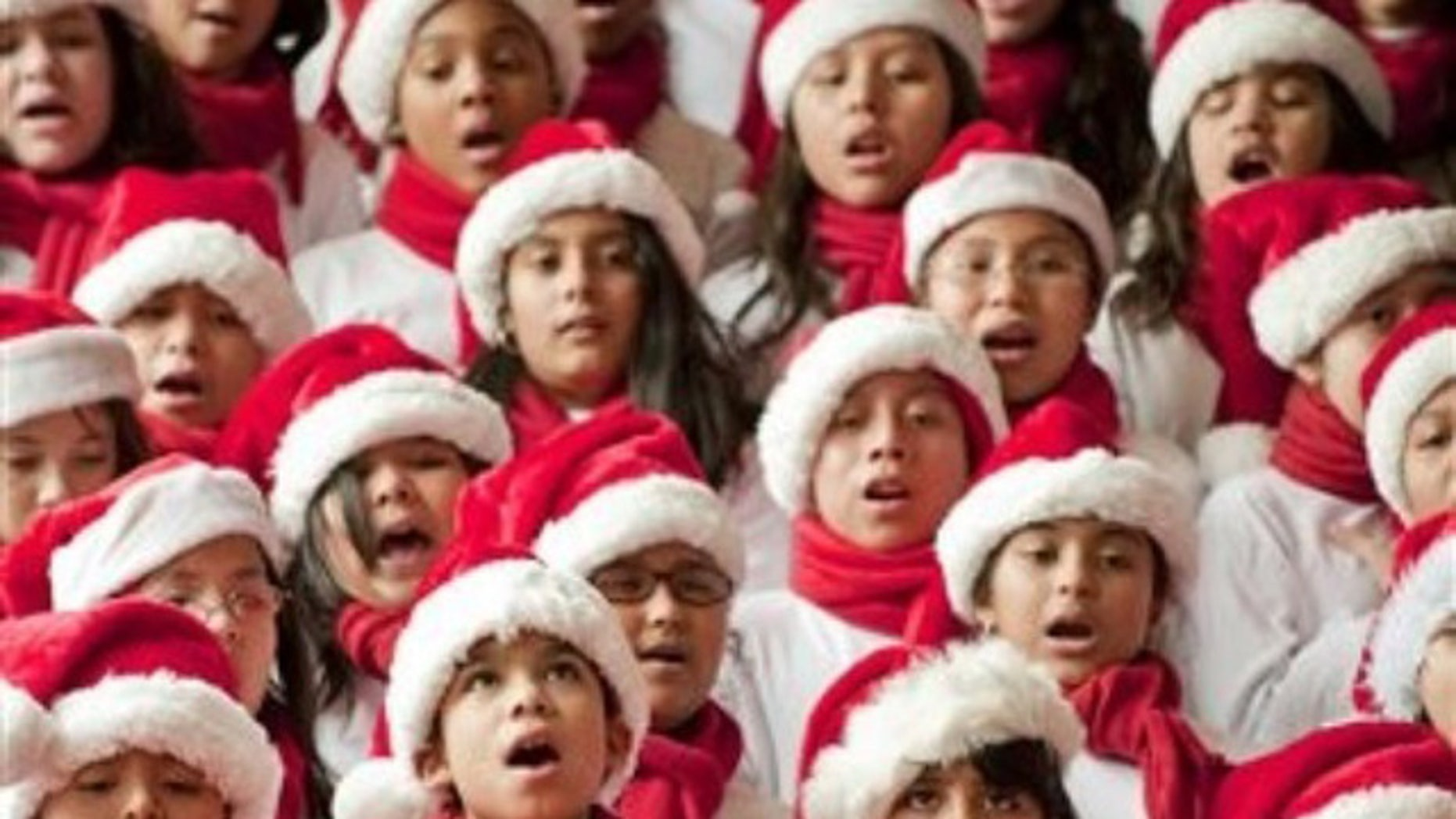 Students from the Pilgrim Academy sing Christmas songs in a hotel lobby. One accoustic researcher believes the notes in popular holiday tunes were borrowed from human speech.