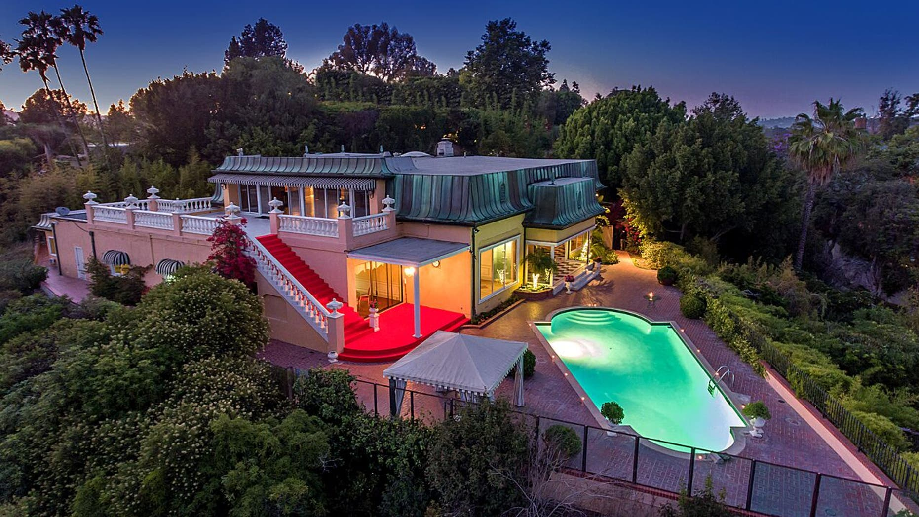 This classic 1950s Bel Air mansion is also rumored to be occupied by Howard Hughes and Elvis Presley.