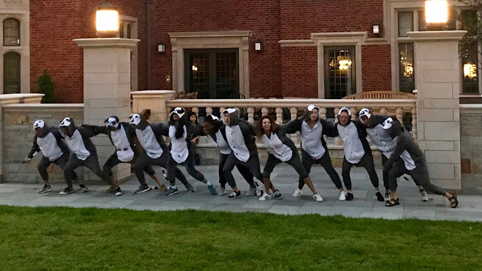 Students at Yale University's newly-opened Pauli Murray residential college put on lemur costumes while performing a chant and dance.