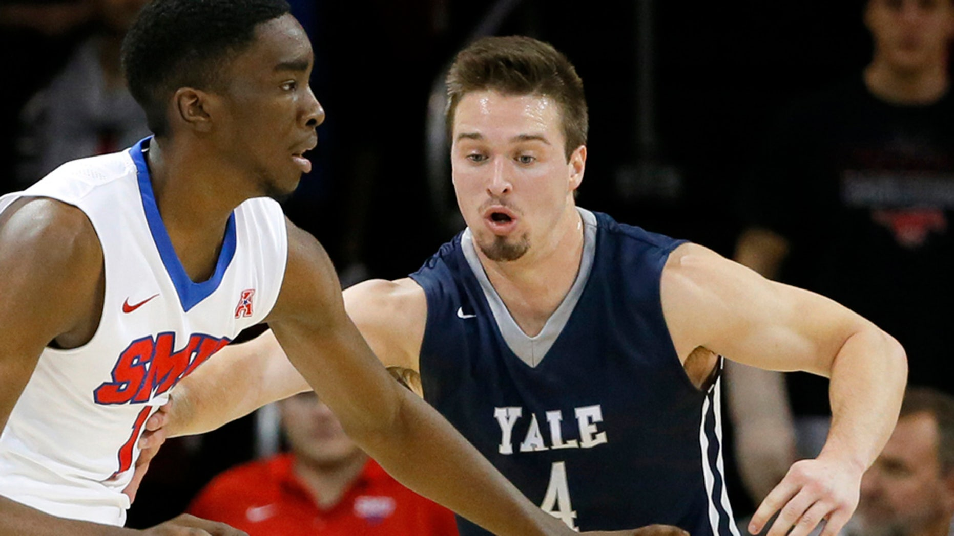 FILE - In this Nov. 22, 2015, file photo, Yale's Jack Montague, right, defends against SMU guard Shake Milton during an NCAA college basketball game in Dallas. (AP Photo/Tony Gutierrez, File)