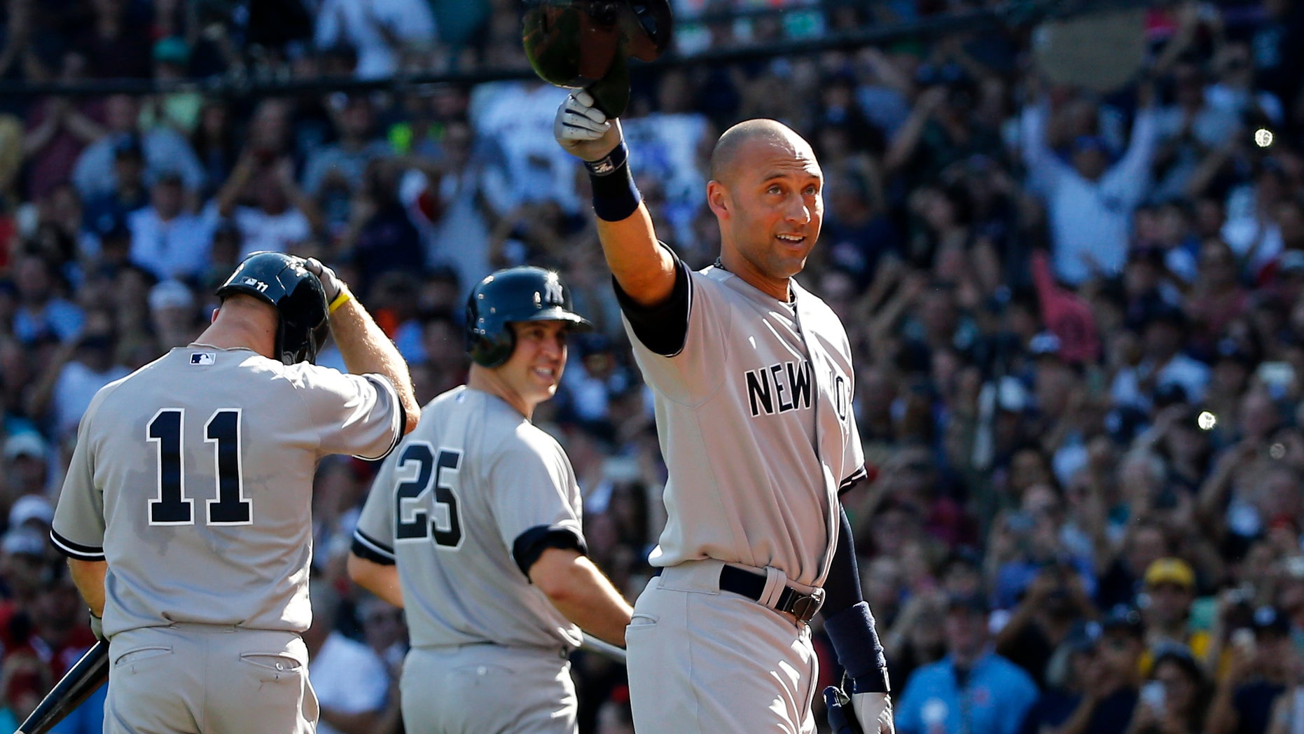 Sept. 28, 2014: New York Yankees designated hitter Derek Jeter tips his cap to the crowd at Fenway Park after coming out of the baseball game for a pinch-runner in the third inning against the Boston Red Sox in a baseball game.