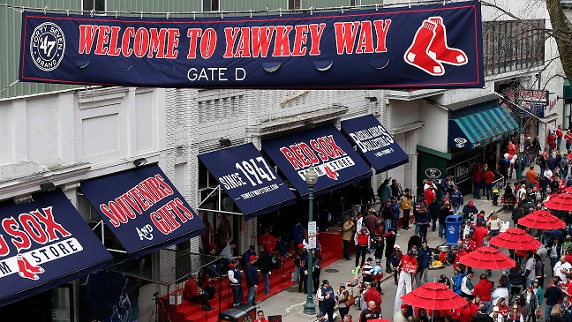 The owner of the Boston Red Sox said he will ask the city to rename Yawkey Way, a street that he called a haunting reminder of the ballclub's history of racial intolerance.