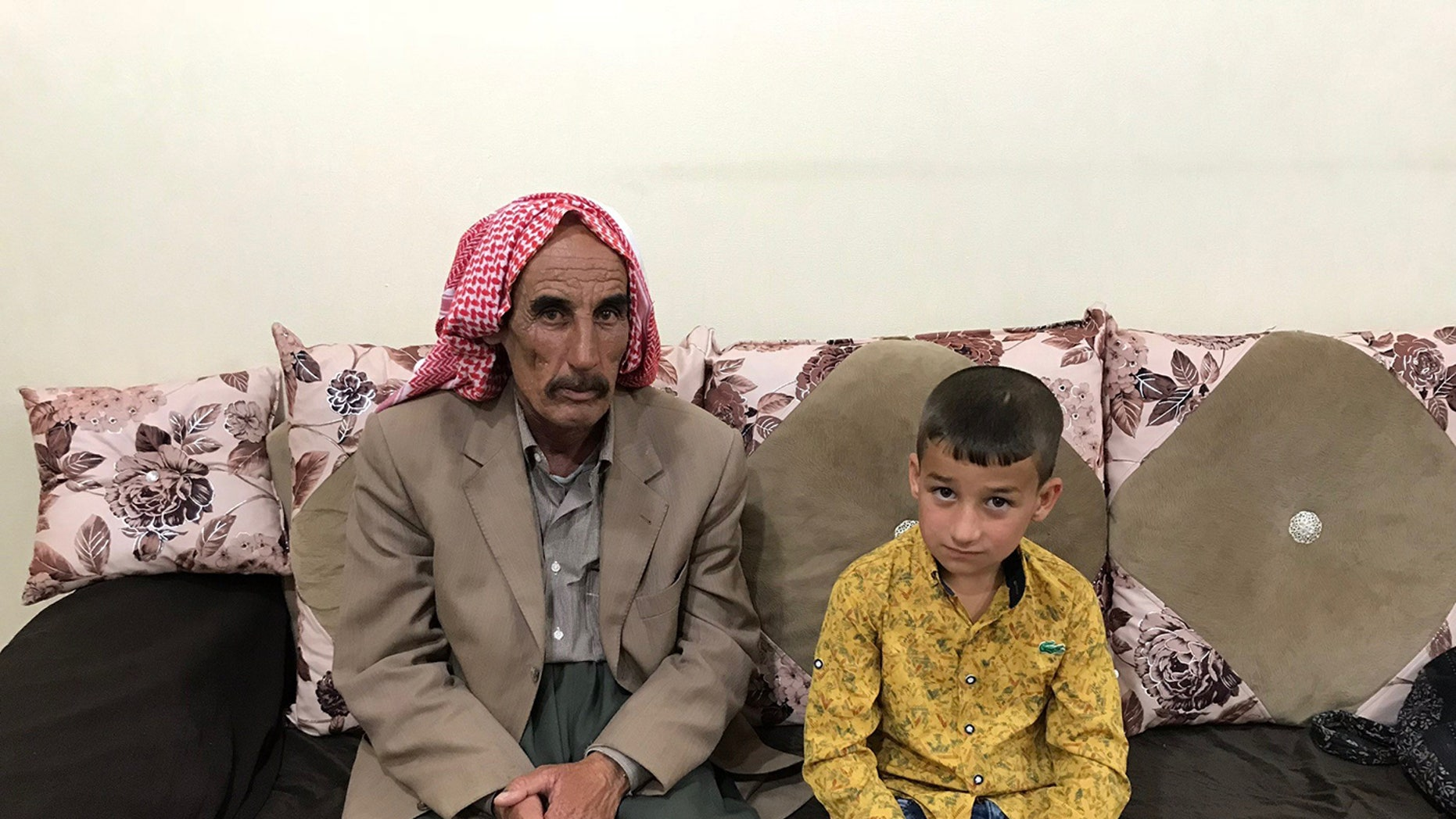 Yazidi father Kassim reunited with his son Lazem, 6, who was held by an ISIS family in Turkey