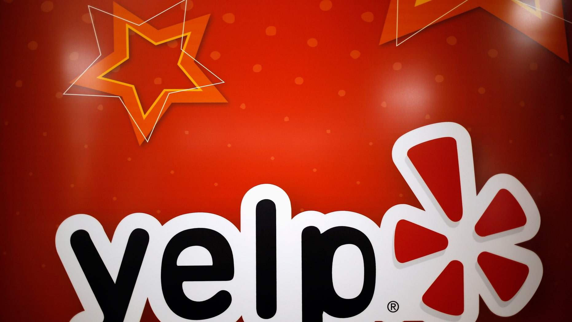 File photo - The Yelp Inc. logo is seen in their offices in Chicago, Illinois, March 5, 2015. (REUTERS/Jim Young)