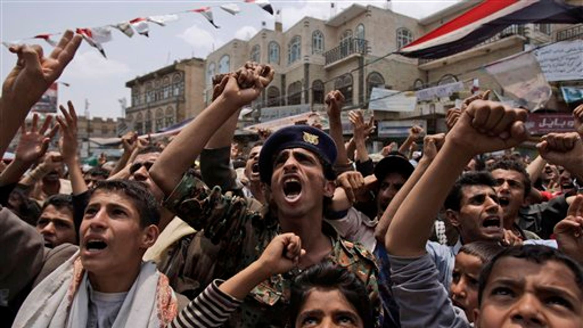 June 29: Anti-government protestors, shout slogans during a demonstration demanding the resignation of Yemeni President Ali Abdullah Saleh, in Sanaa, Yemen. Yemeni government warplanes and artillery pounded several villages of anti-government tribes north of the capital on Tuesday, killing at least three people, a senior tribal leader said.
