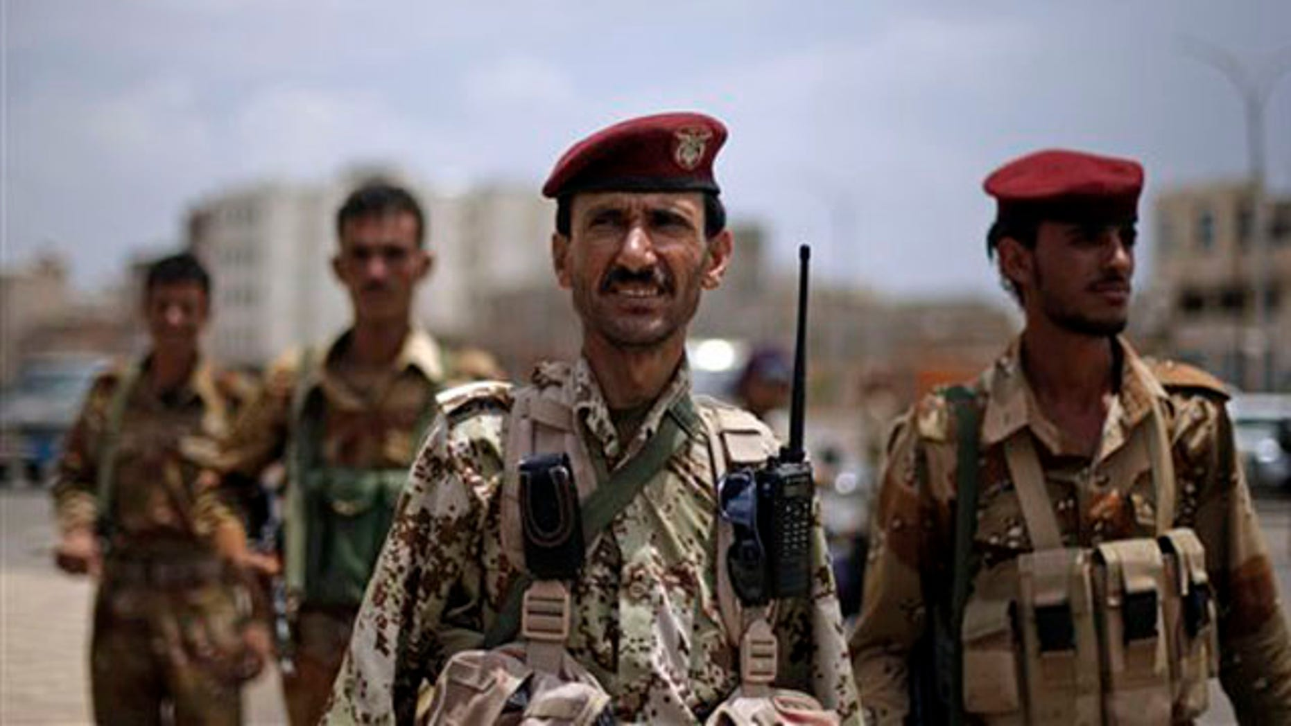 A Yemeni soldier who defected looks on as he stands guard with others at a checkpoint next to the site of a demonstration by anti-government protestors demanding the resignation of Ali Abdullah Saleh in Sanaa, Yemen, Thursday, Sept. 8, 2011.