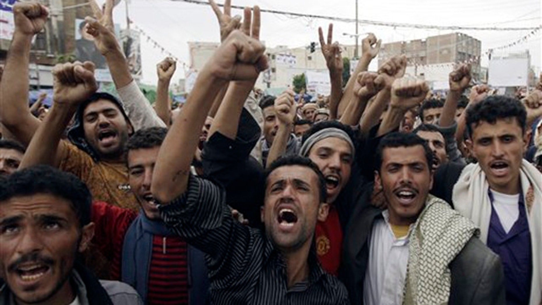 Yemeni protestors chant slogans during a demonstration demanding the resignation of Yemeni president Ali Abdullah Saleh in Sanaa, Yemen Wednesday, Sept. 14, 2011.