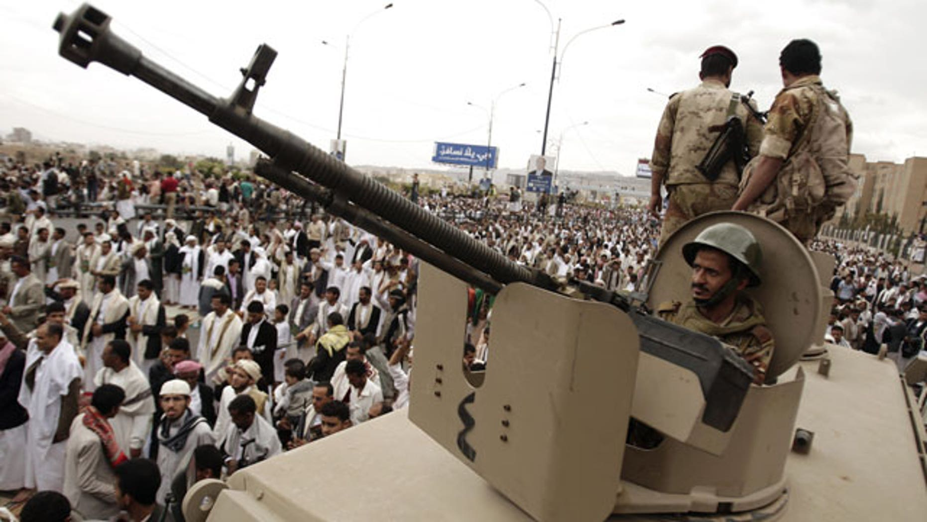 Mar. 30, 2012: A defected army soldier supporting protestors looks on from behind a weapon mounted on a patrol truck to secure a street where protestors demand the trial of Yemen's former President Ali Abdullah Saleh, in Sanaa, Yemen.