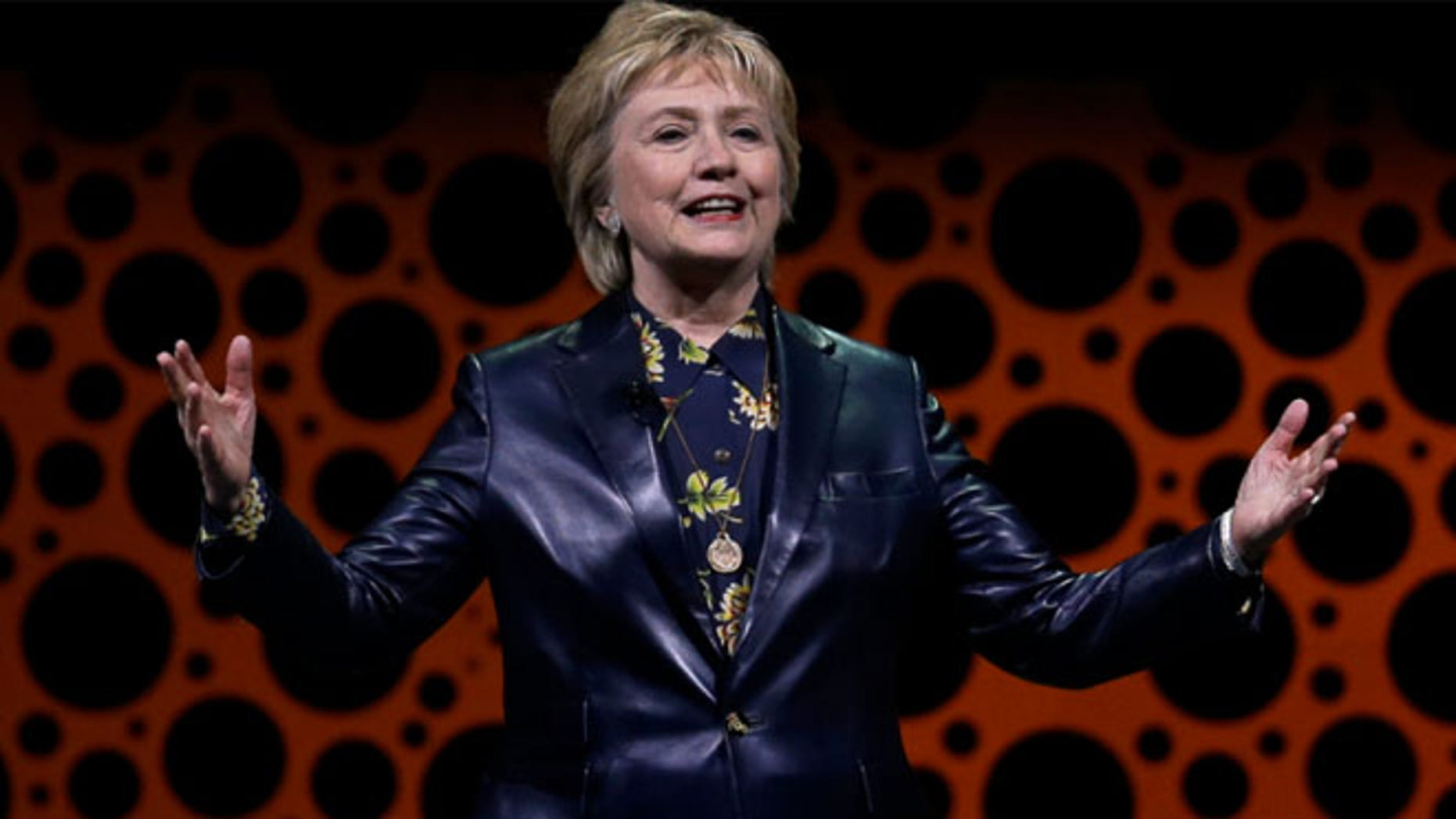 Former Secretary of State Hillary Clinton gestures while speaking before the Professional Businesswomen of California
