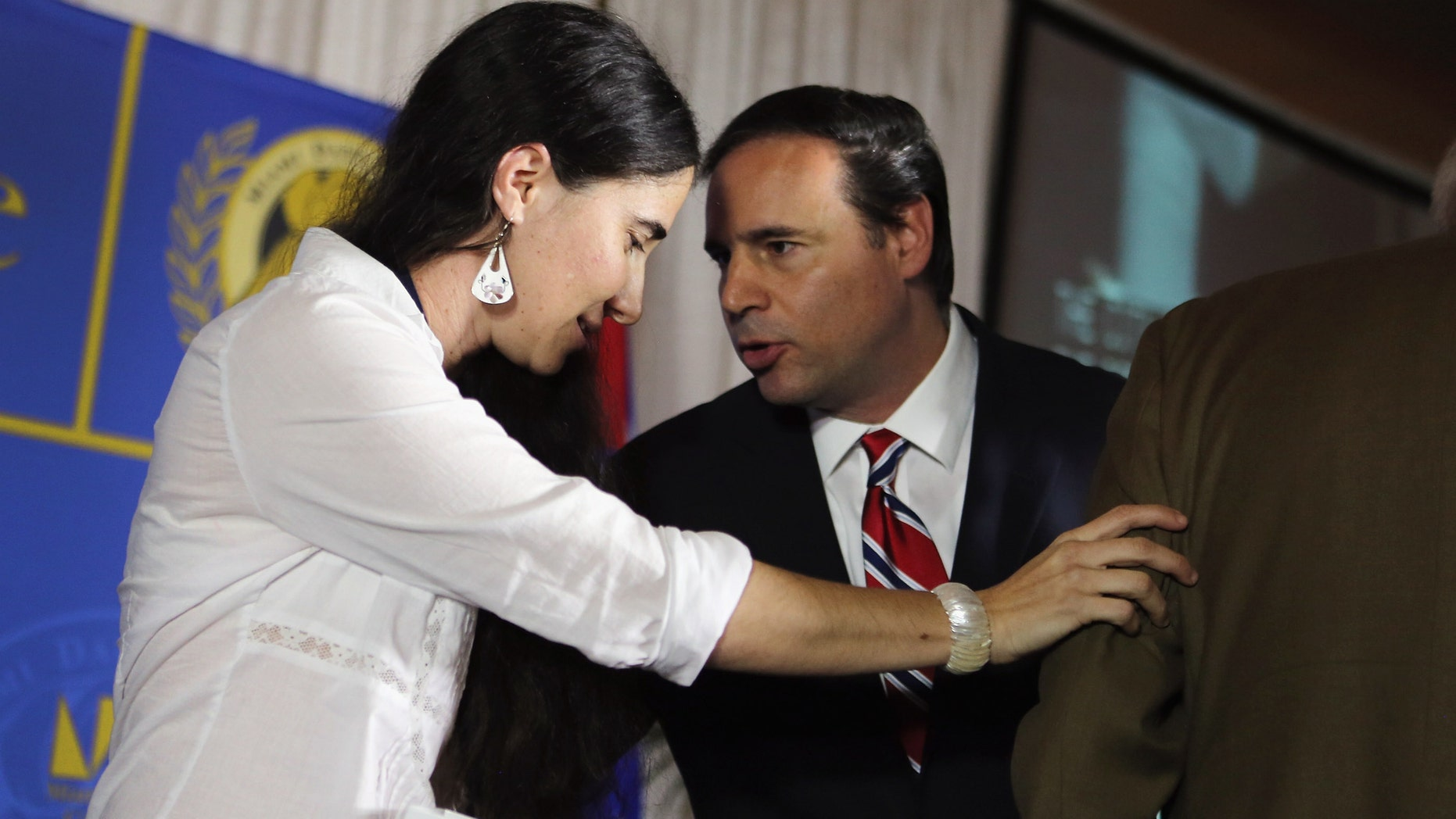 Yoani Sanchez and Miami City Commissioner Frank Carollo on April 1, 2013 in Miami, Florida.