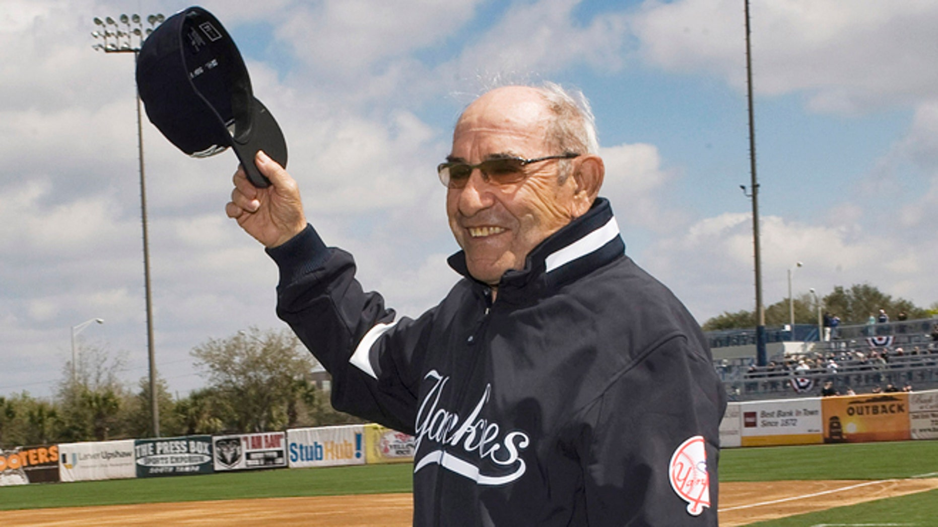 March 3, 2010: Former New York Yankees' player, manager and coach Yogi Berra waves to the crowd before the Yankees home opener spring training baseball game against the Pittsburgh Pirates at George M. Steinbrenner Field in Tampa, Florida.