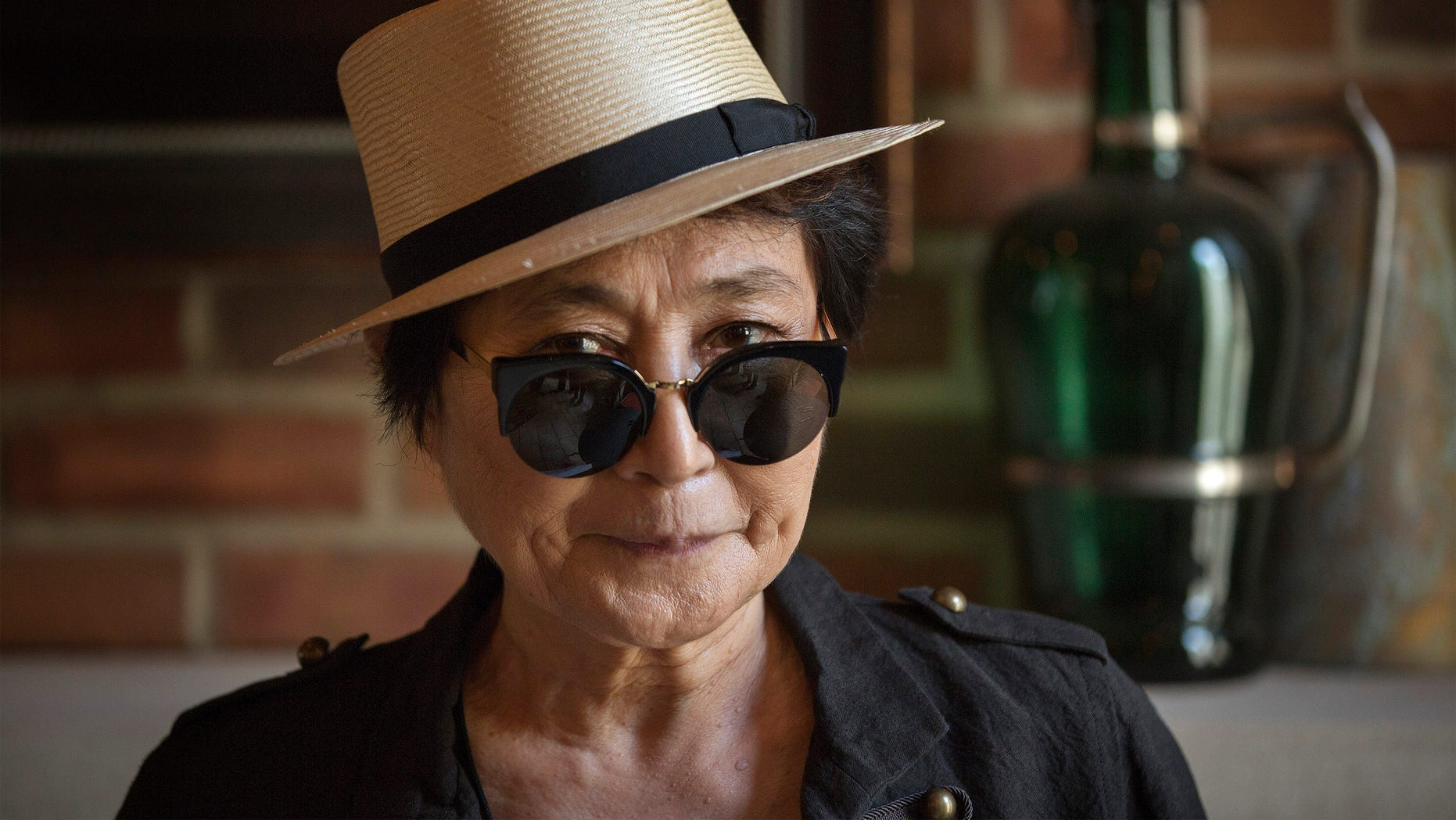 """July 2, 2013. Yoko Ono poses for a photograph while promoting her new book """"Acorn"""" during a book signing in New York."""