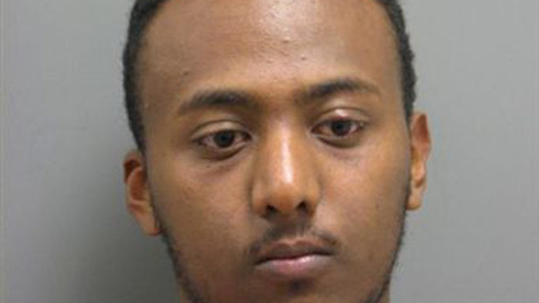 Yonathan Melaku is charged with four counts of grand larceny.
