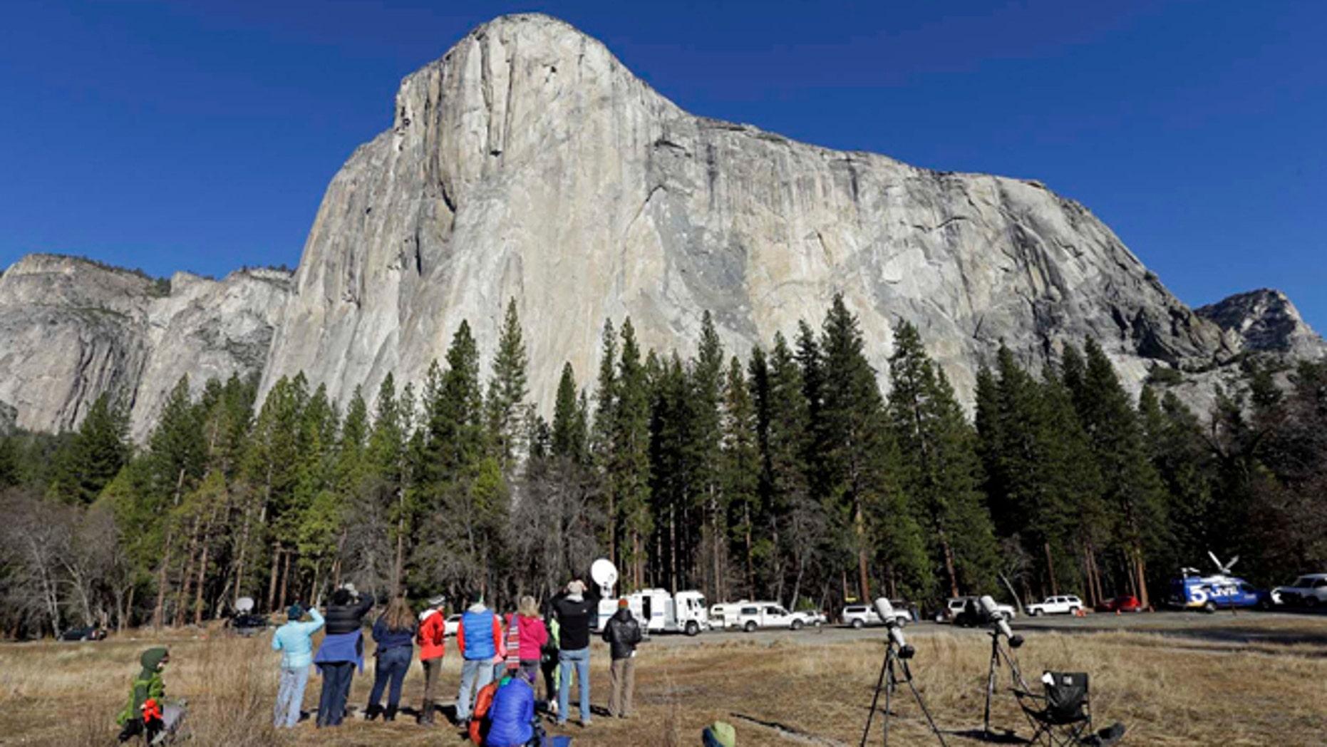 Jan. 14, 2015: Spectators gaze at El Capitan, as seen from the valley floor in Yosemite National Park, Calif.