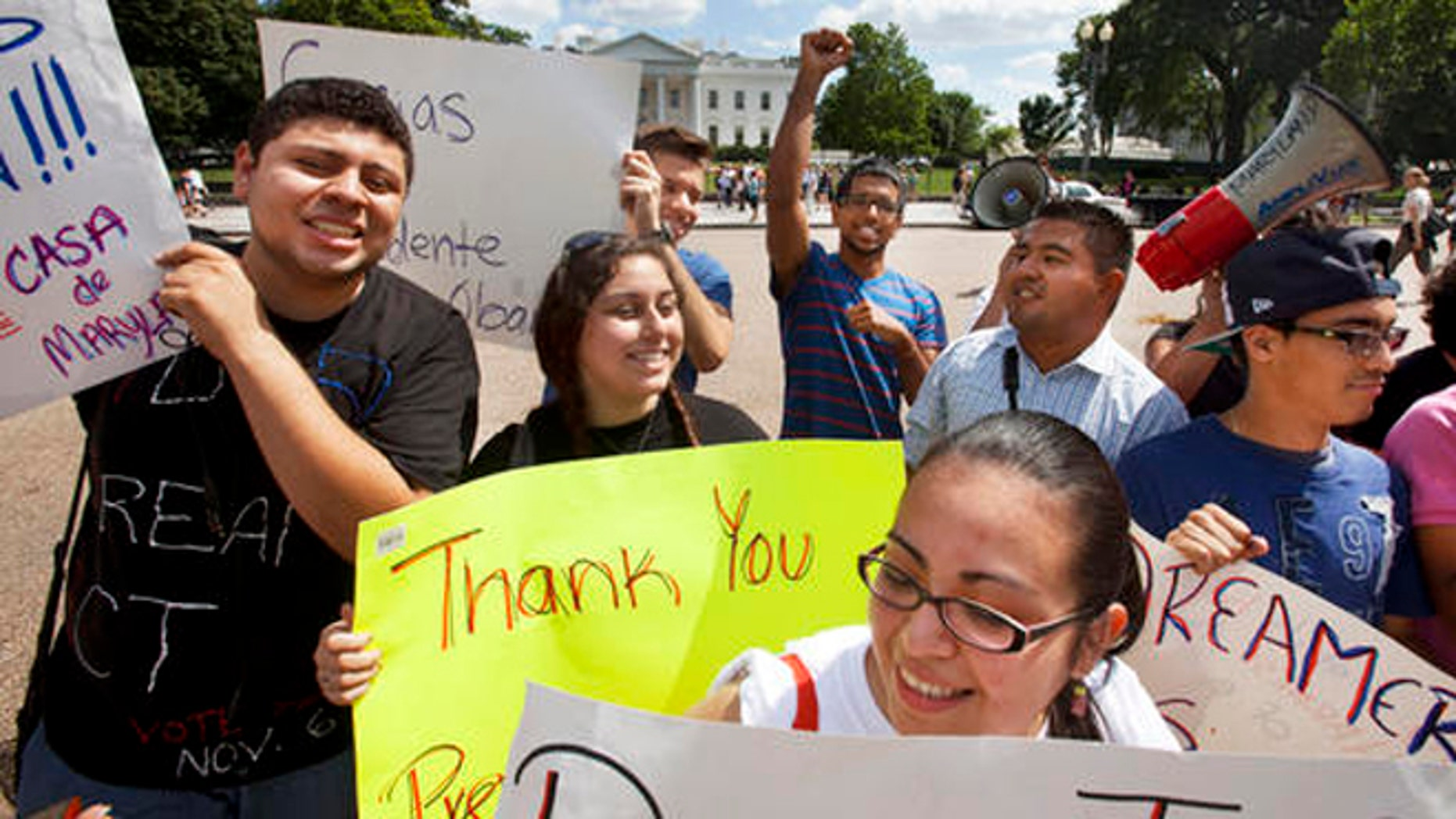 FILE - In this June 15, 2012 file photo, young demonstrators participate in a rally in support of President Barack Obama after the president announced that the U.S. government will stop deporting and begin granting work permits to younger illegal immigrants who came to the U.S. as children and have since led law-abiding lives. Young Hispanic and Asian-Americans who are immigrants themselves or have a parent who is are more likely to be liberal in their views on politics and immigration than those with families who have been in United States longer, a new GenForward poll shows. (AP Photo/Jacquelyn Martin, File)