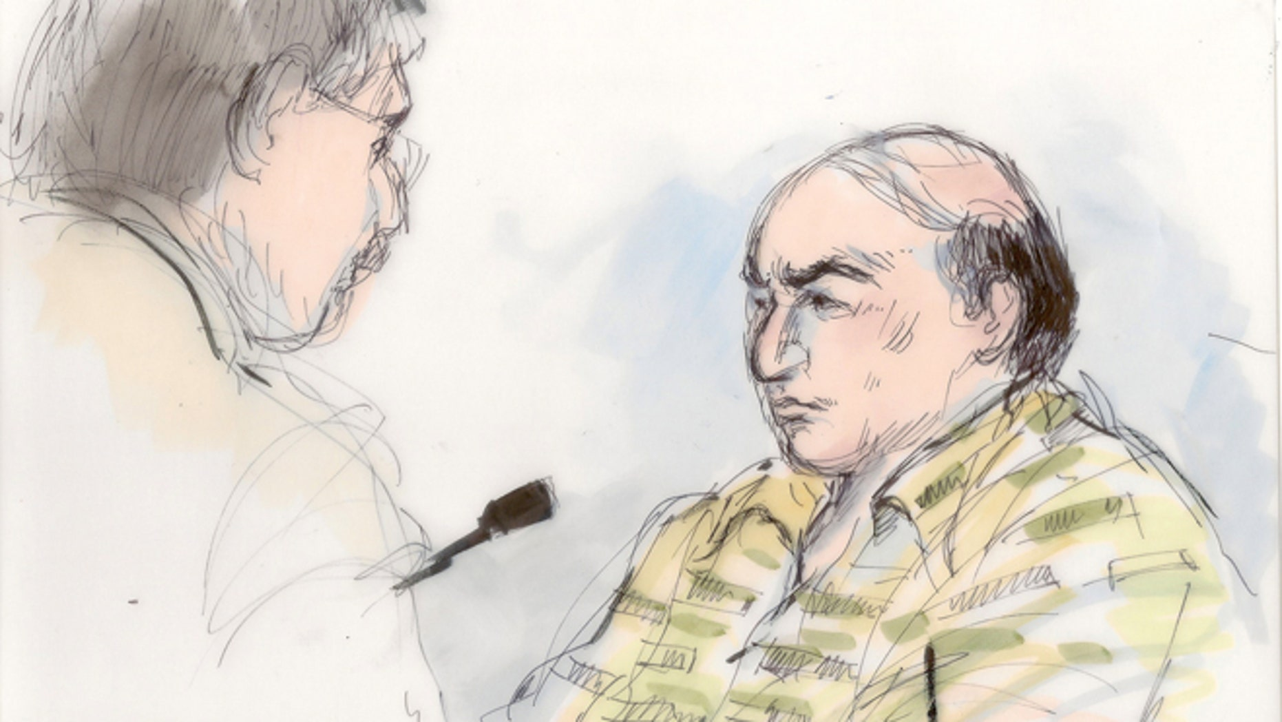 Sept. 27, 2012: This file courtroom sketch shows shows Mark Basseley Youssef talking with his attorney Steven Seiden, left, in court in Los Angeles.