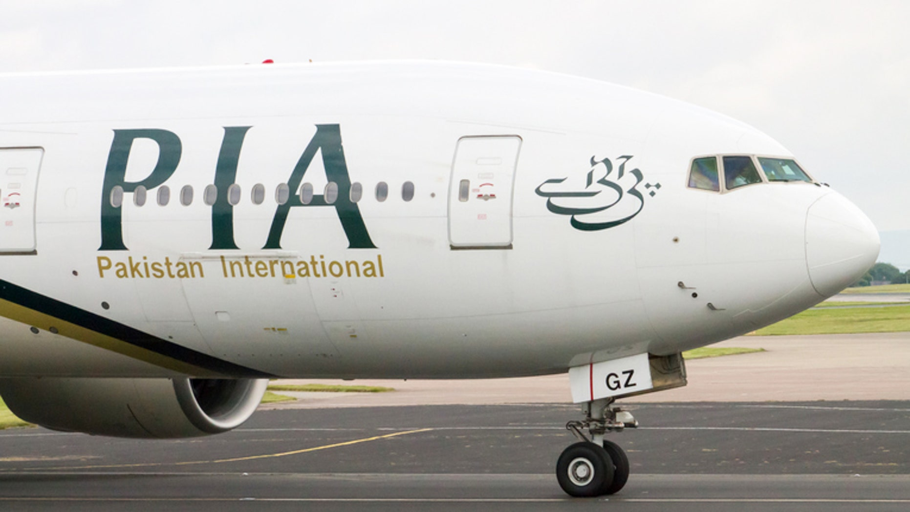 Manchester, United Kingdom - June 14, 2014: PIA Airlines Boeing 777 taxiing, Manchester International Airport. Prime Minister of Pakistan, Mr. Muhammad Nawaz Sharif, has expressed resolve to make PIA World's leading airline.