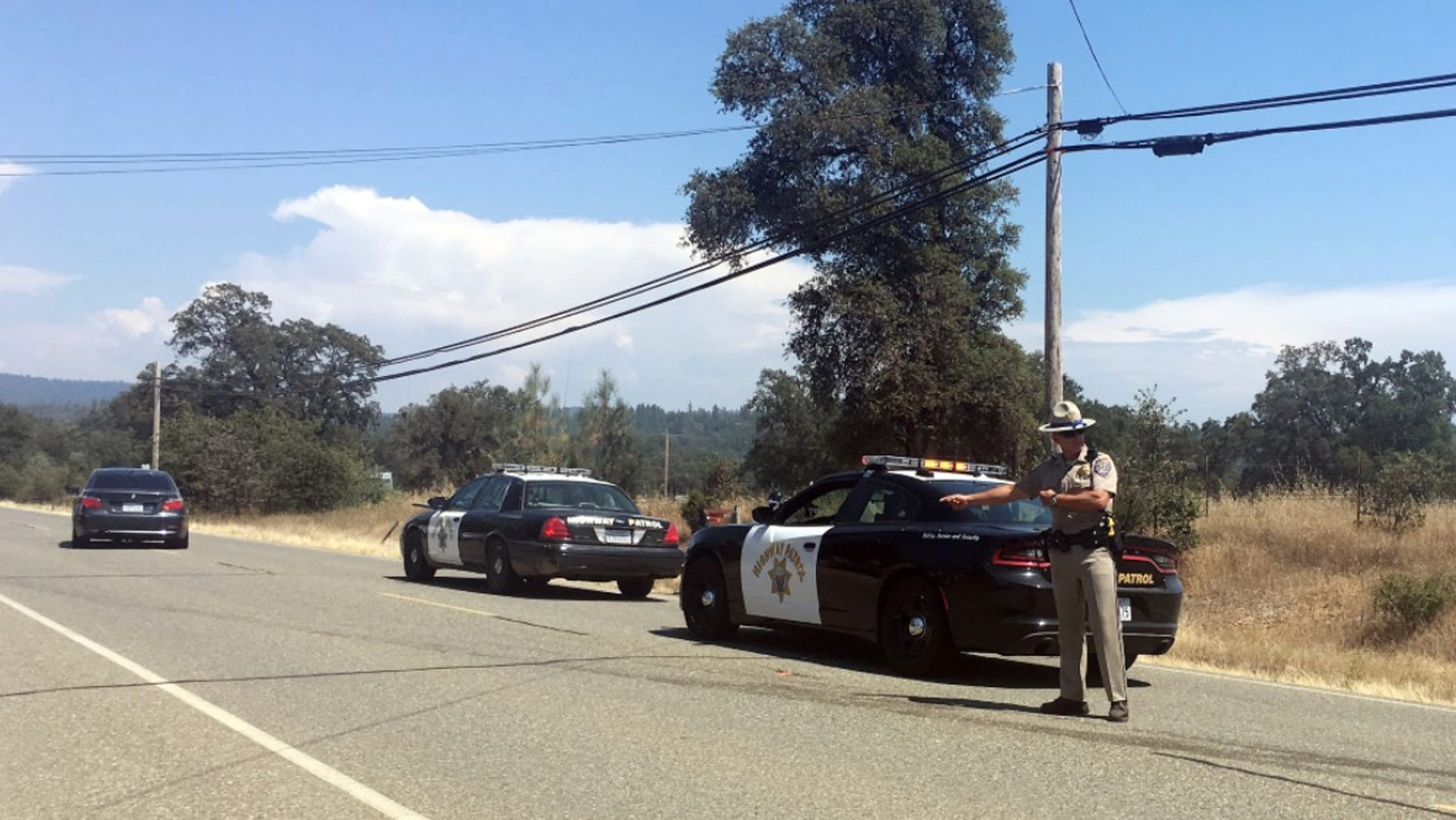 Two California sheriff's deputies were shot and wounded Tuesday after they responded to reports of an armed and agitated man pulling up plants in the garden of a rural Rastafarian church, authorities said. (AP Photo/Sophia Bollag)