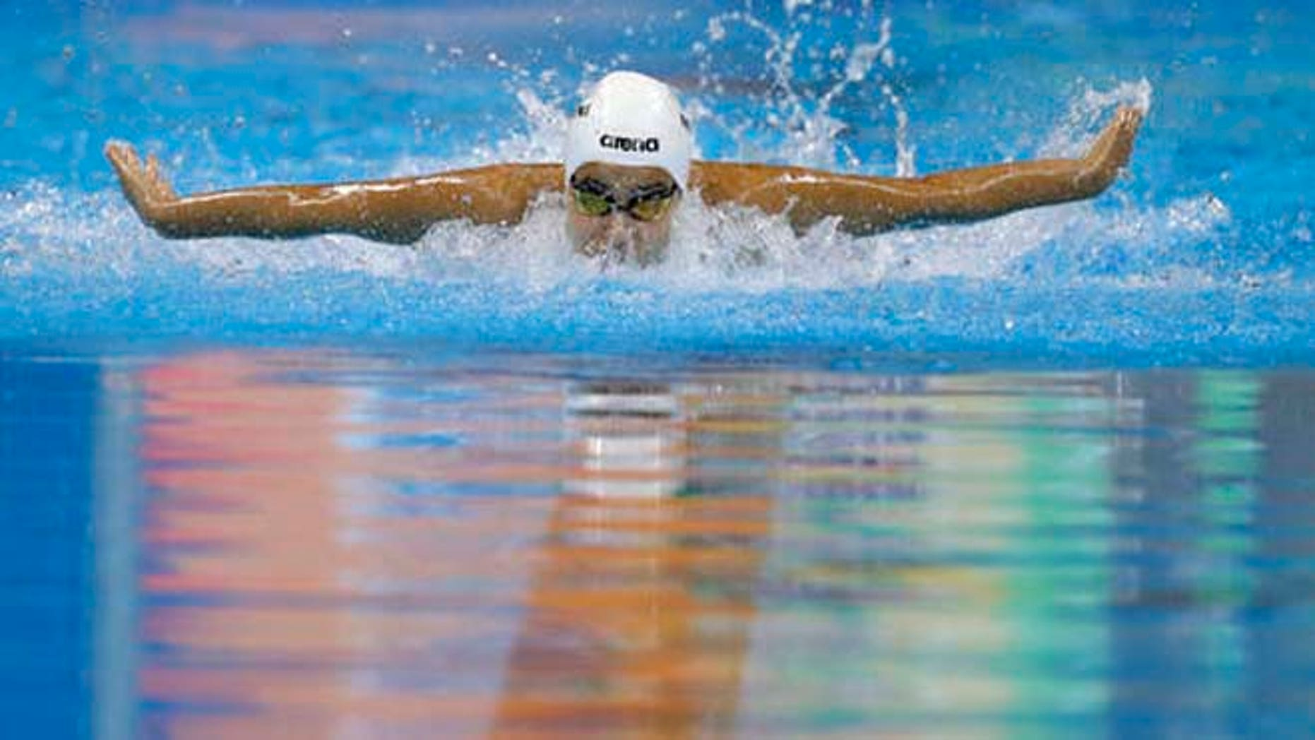 Yusra Mardini, swimming for the Refugee Olympic Team, competes in a women's 100m butterfly heat during the swimming competitions at the 2016 Summer Olympics, Saturday.