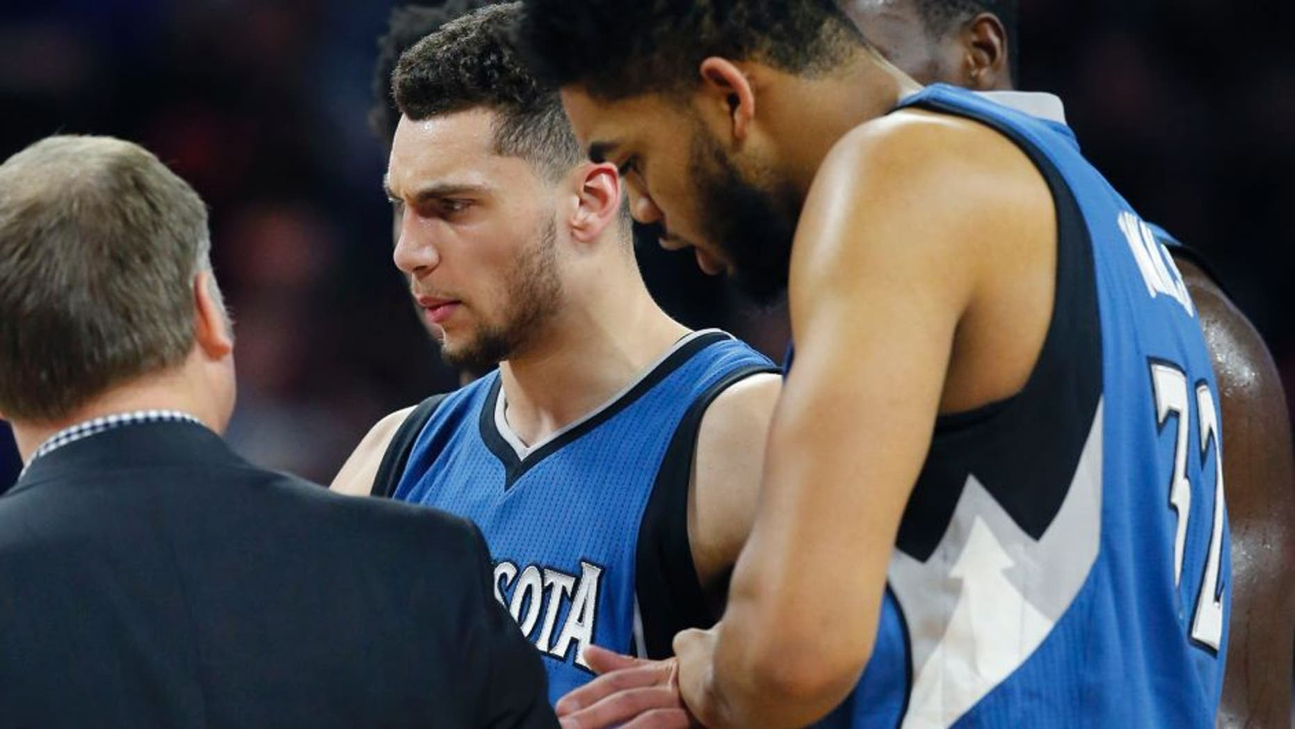 Minnesota Timberwolves guard Zach LaVine is helped off the court during the second half of the team's NBA basketball game against the Detroit Pistons, Friday, Feb. 3, 2017, in Auburn Hills, Mich. (AP Photo/Carlos Osorio)