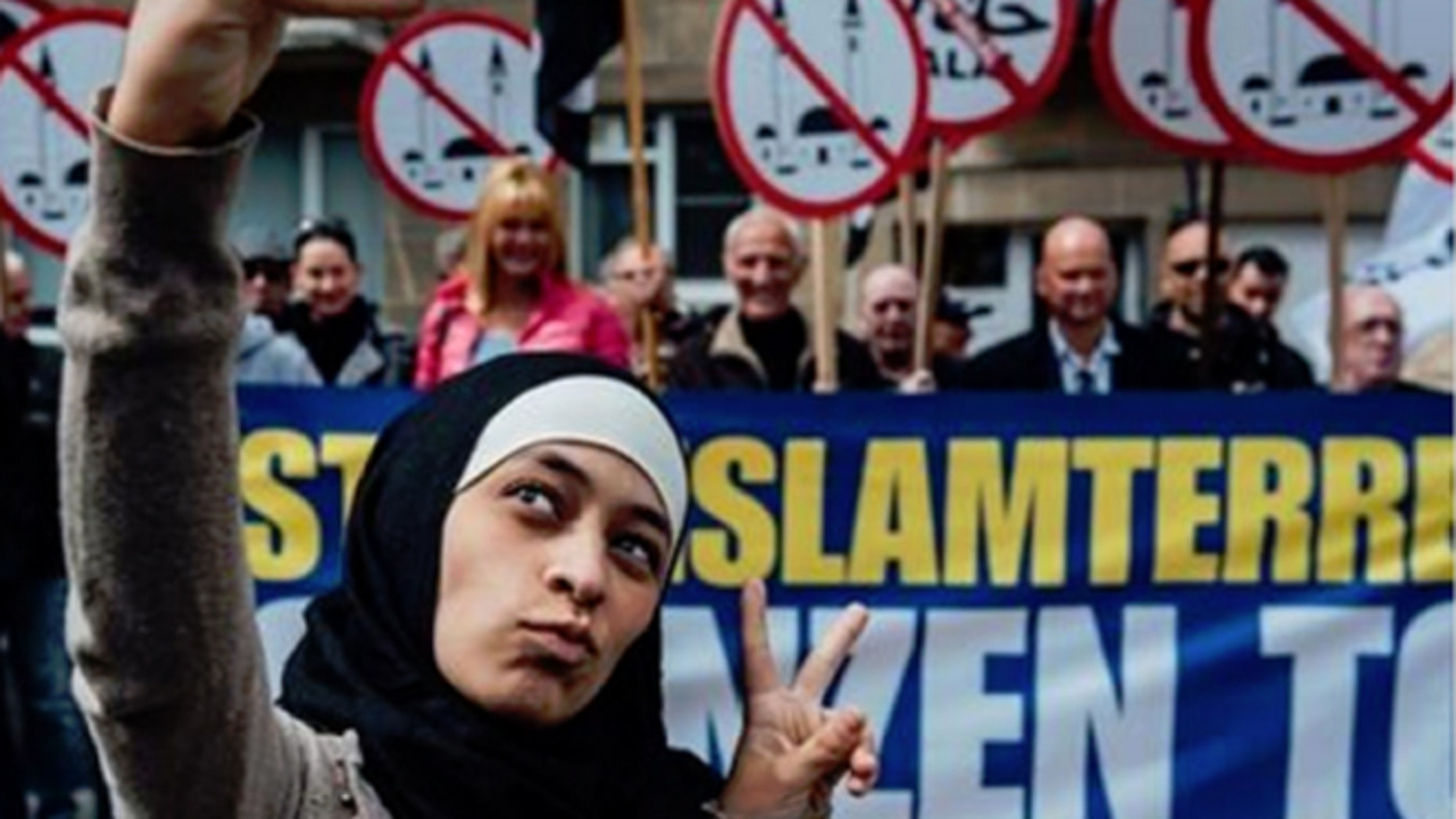 Pictures of her taking a peace sign selfie in front of protesters made Zakia Belkhiri a media darling - briefly.