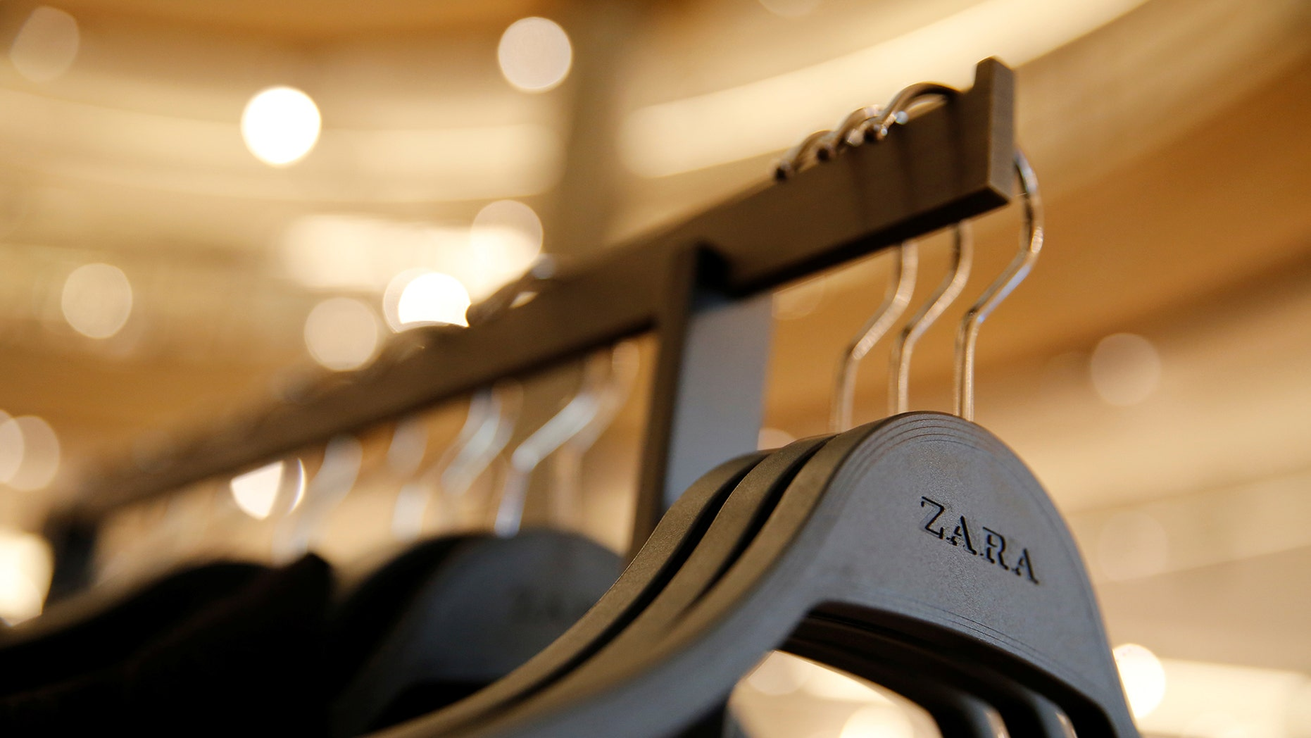 Clothes hangers are seen in a Zara store, an Inditex brand, in central Barcelona, Spain, December 13, 2016.