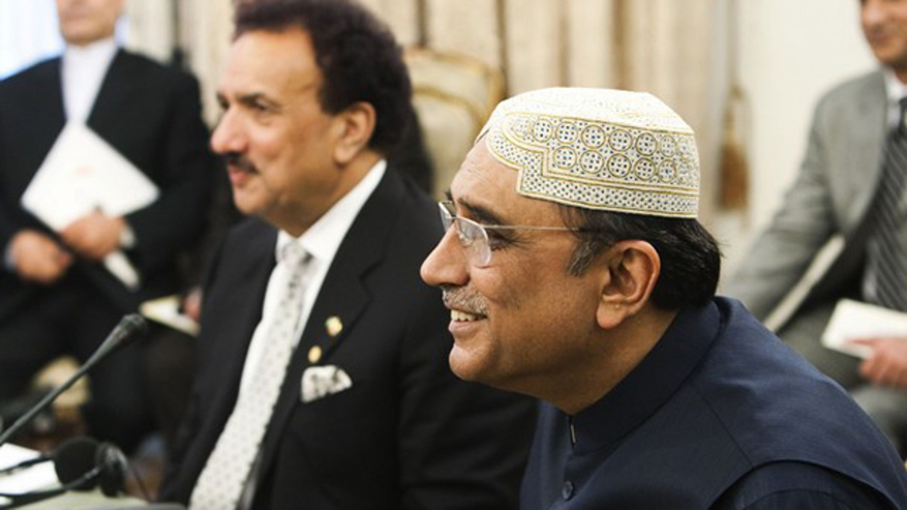FILE: Pakistani President Asif Ali Zardari, right, and Pakistani Interior Minister Rahman Malik attend a trilateral meeting with their Iranian and Afghan counterparts in Tehran June 24.