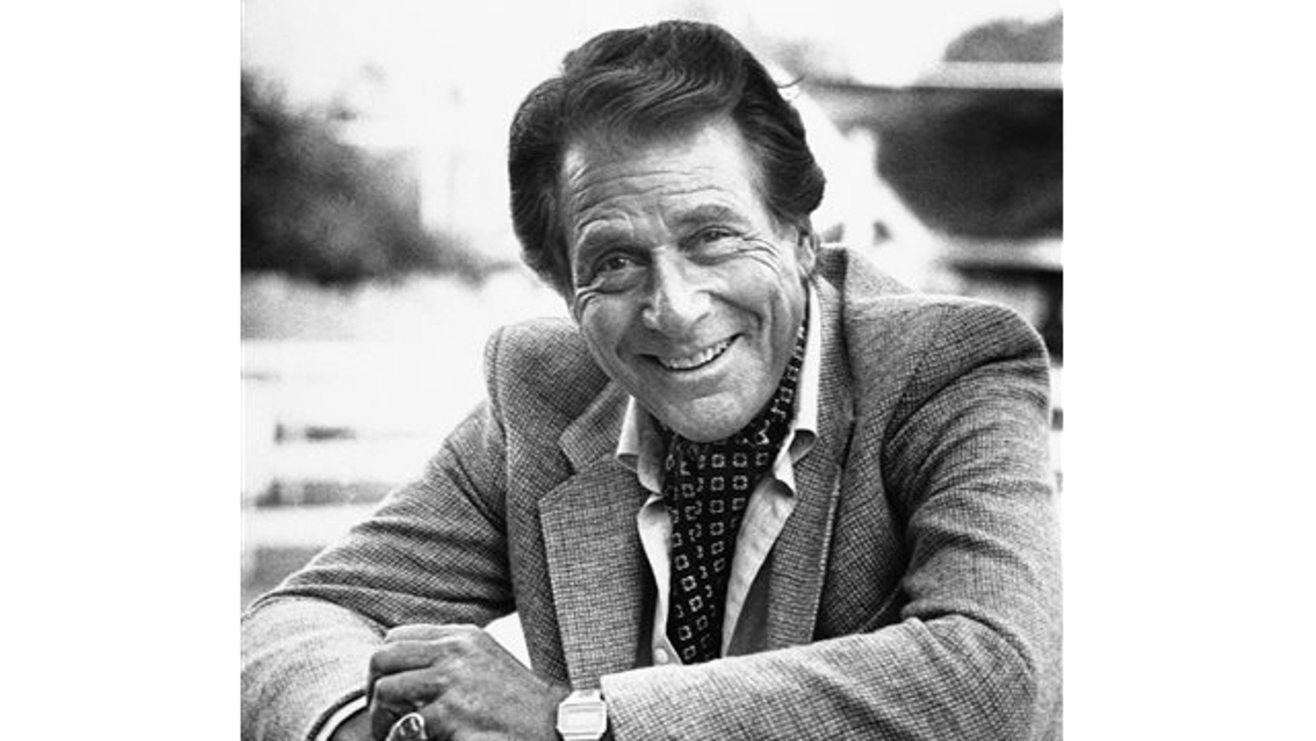 """FILE: Feb. 16, 1982: Veteran actor Efrem Zimbalist, Jr., known for his starring roles in """"77 Sunset Strip"""" and """"The FBI,"""" stands outside his home, in Los Angeles, Calif. Zimbalist, the son of famous musicians who gained television stardom in the 1950s-60s hit """"77 Sunset Strip"""" and later """"The FBI,"""" died Friday at his ranch in Solvang, Calif., at age 95."""