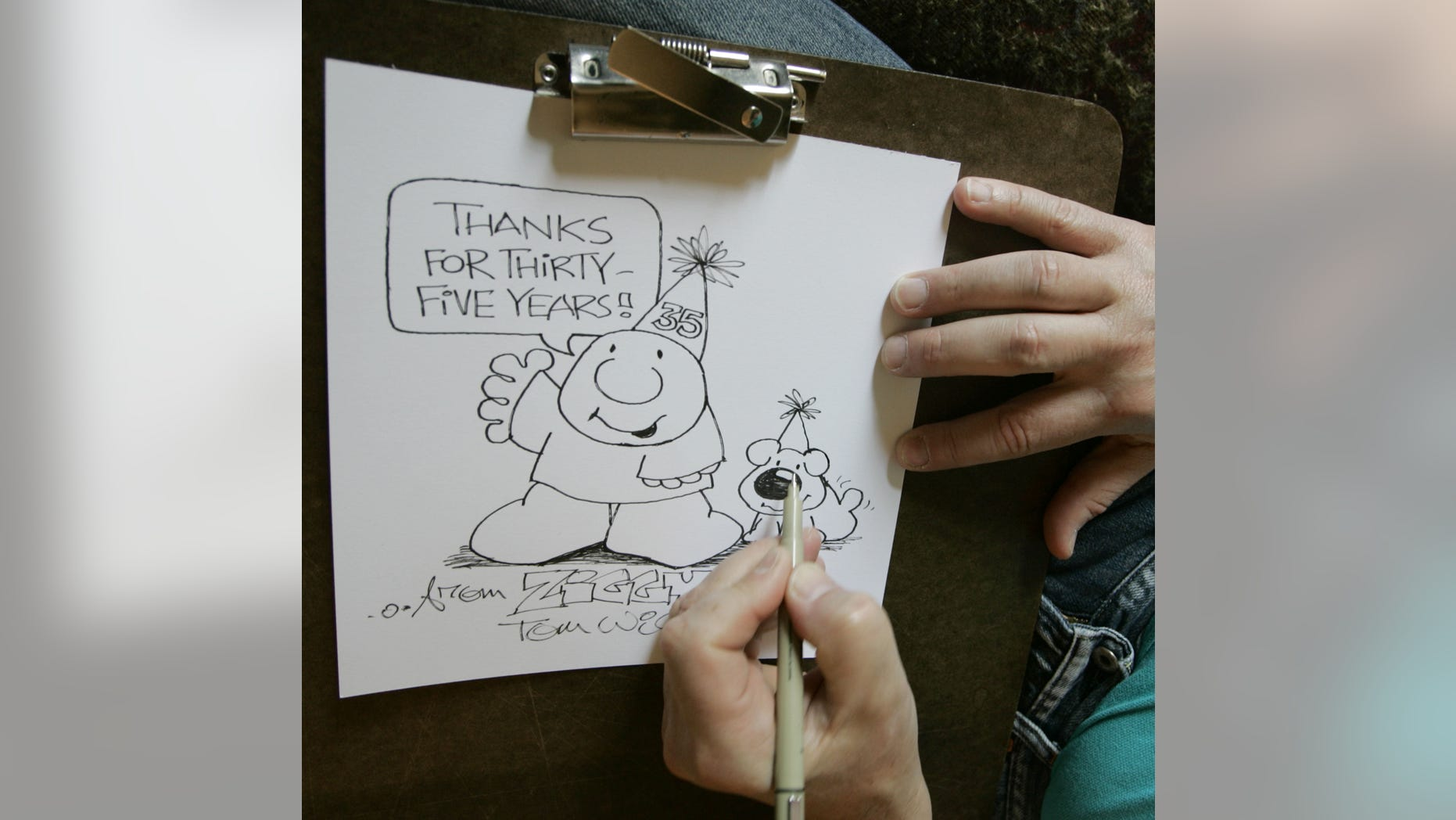In this June 23, 2006 photo, Artist Tom Wilson Jr. draws a Ziggy cartoon celebrating the strip's 35th anniversary at his home in Loveland, Ohio.  Tom Wilson Sr, the creator of hard-luck comic strip character Ziggy has died, he was 80. Spokesman Josh Peres with Universal Uclick, the Kansas City, Missouri, syndication company formerly known as Universal Press Syndicate, says Wilson Sr. died Friday, Sept. 16, 2011 after a long illness. Wilson's son, Tom Wilson Jr., who has produced the panel since 1987, says his father died of pneumonia at a Cincinnati hospital.