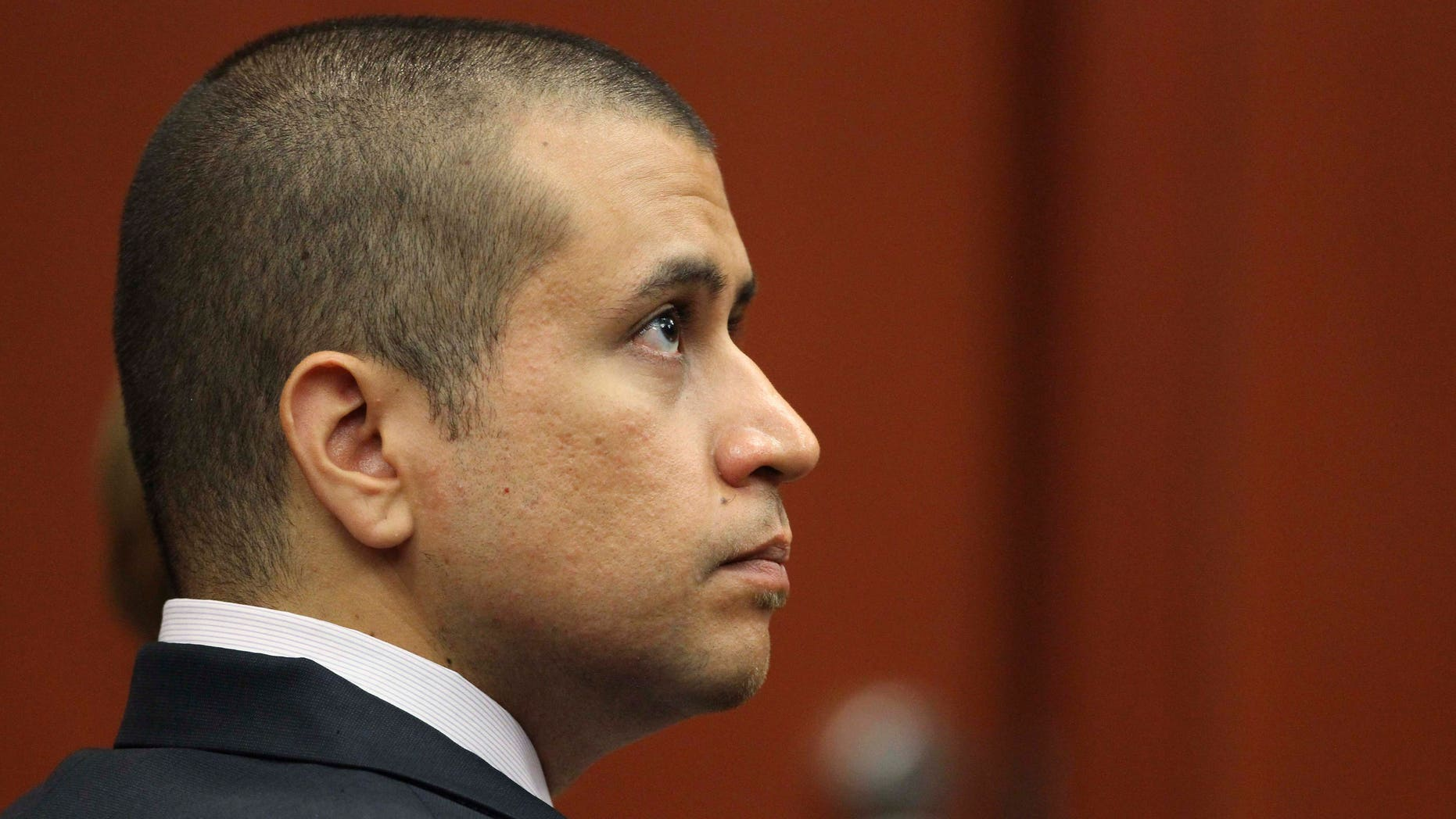 George Zimmerman, shown at an April 20 bond hearing in Sanford, Fla., began carrying a licensed handgun after a pit bull menaced his wife.  (AP Photo/Orlando Sentinel, Gary W. Green, Pool)