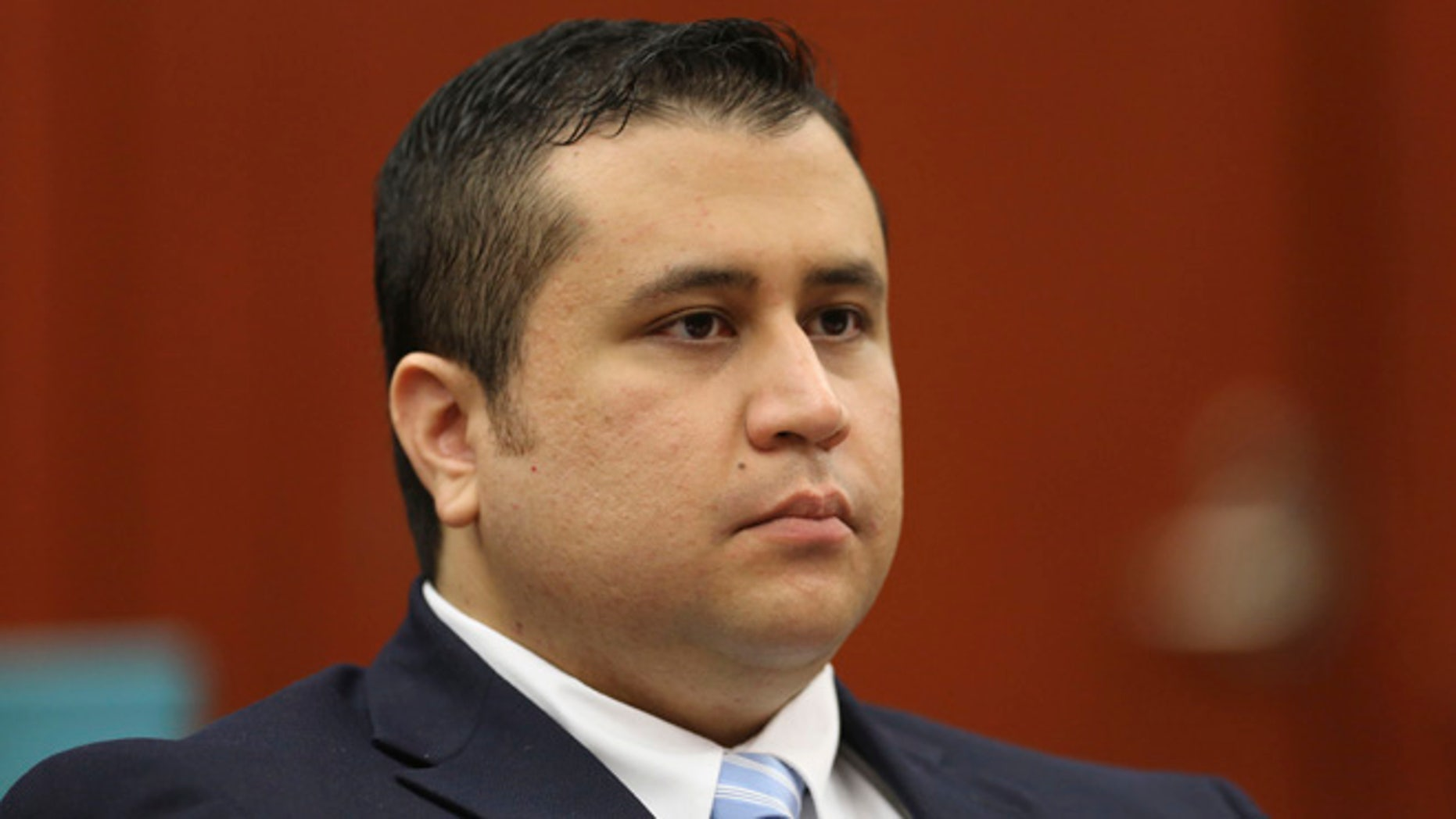June 20, 2013: George Zimmerman listens as his defense counsel Mark O'Mara questions potential jurors during Zimmerman's trial in Seminole circuit court in Sanford, Fla.