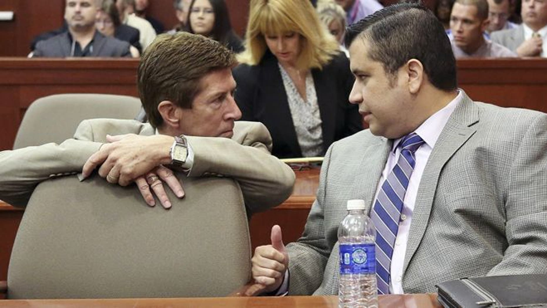 June 27, 2013: George Zimmerman, right, speaks with defense attorney Mark O'Mara during his trial in Seminole circuit court in Sanford, Fla.