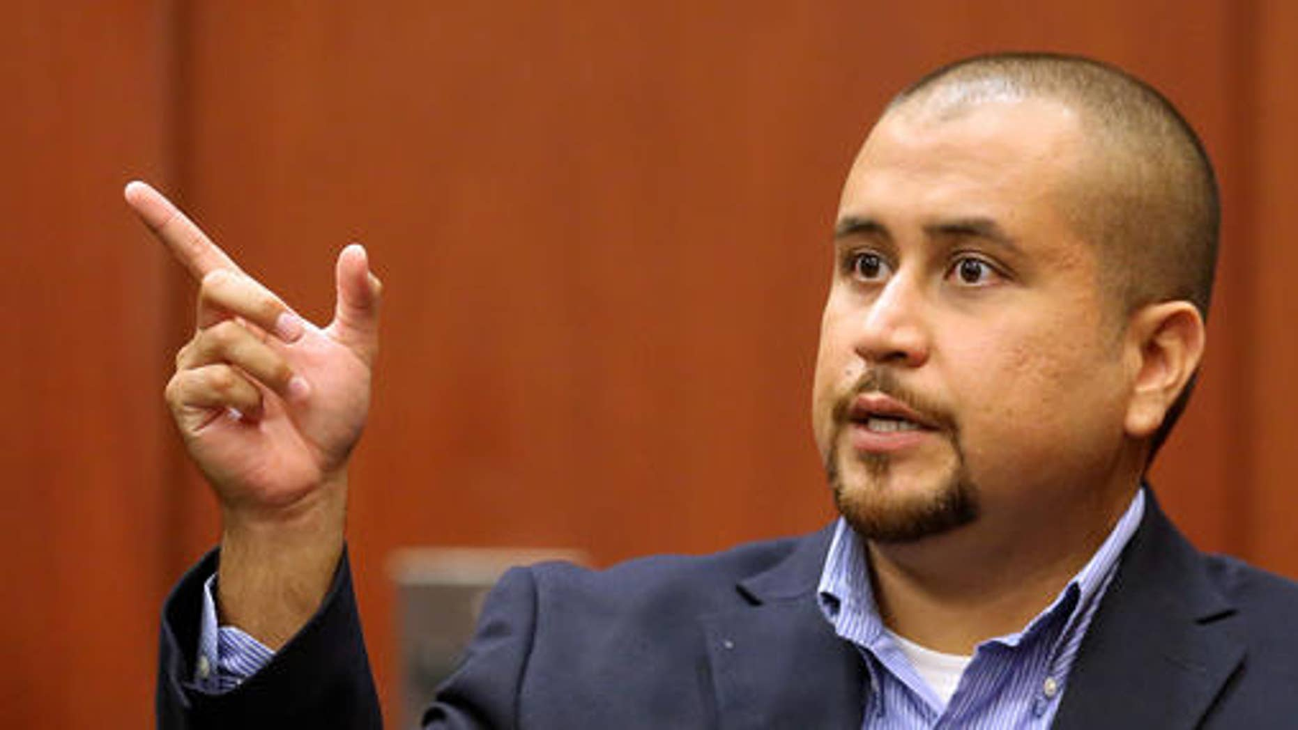 FILE - In this Sept. 22, 2015 file photo, George Zimmerman gestures during his testimony at a hearing for accused shooter Matthew Apperson in Seminole circuit court in Sanford, Fla.   Testimony begins Tuesday, Sept. 13, 2016 in Apperson's attempted second-degree murder trial. Authorities say he shot at Zimmerman during a traffic incident last year. (Joe Burbank/Orlando Sentinel via AP, Pool)