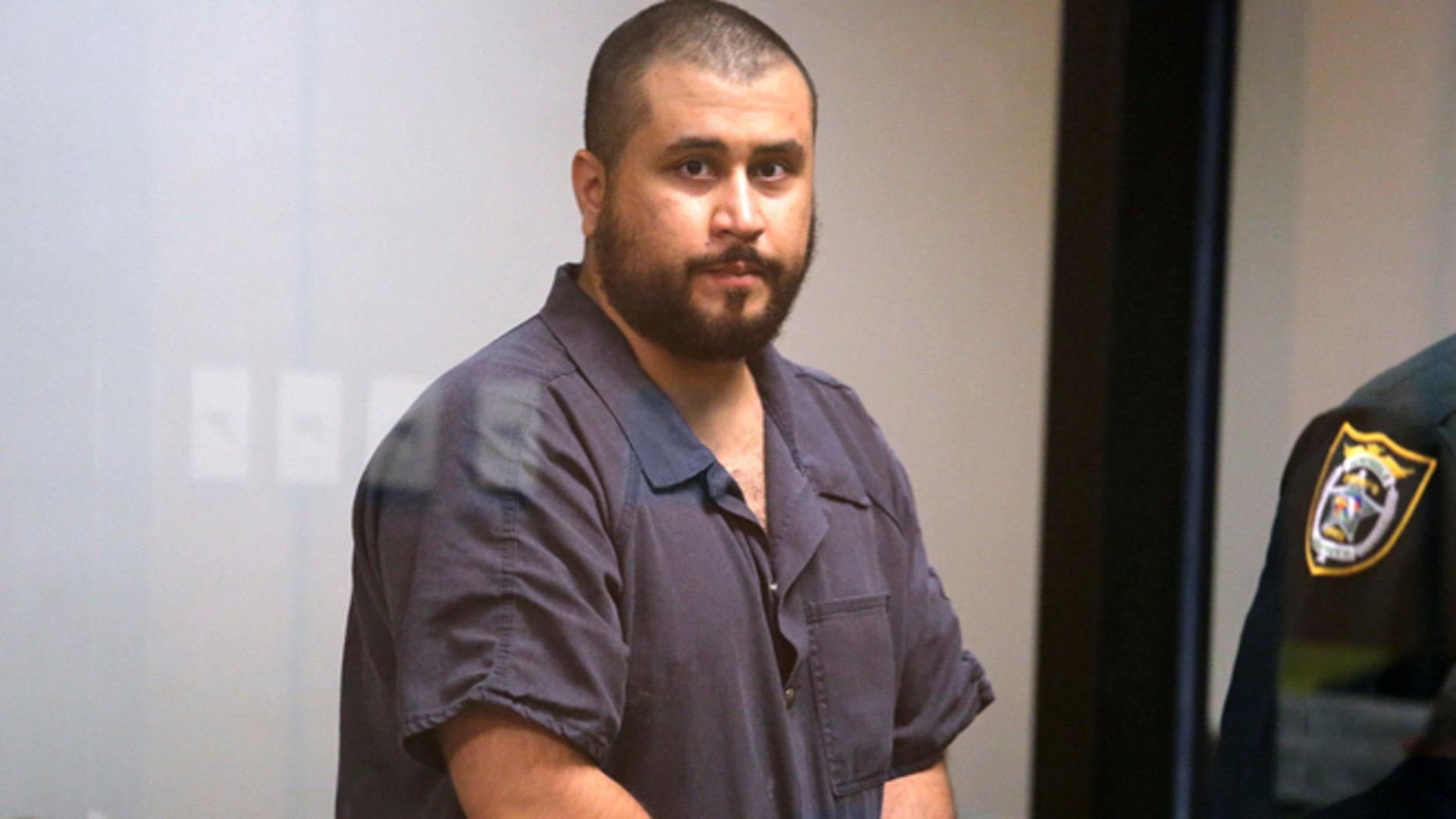 Nov. 19, 2013: George Zimmerman, the acquitted shooter in the death of Trayvon Martin, arrives in Courtroom J2 to face a Seminole circuit judge in Sanford, Florida.