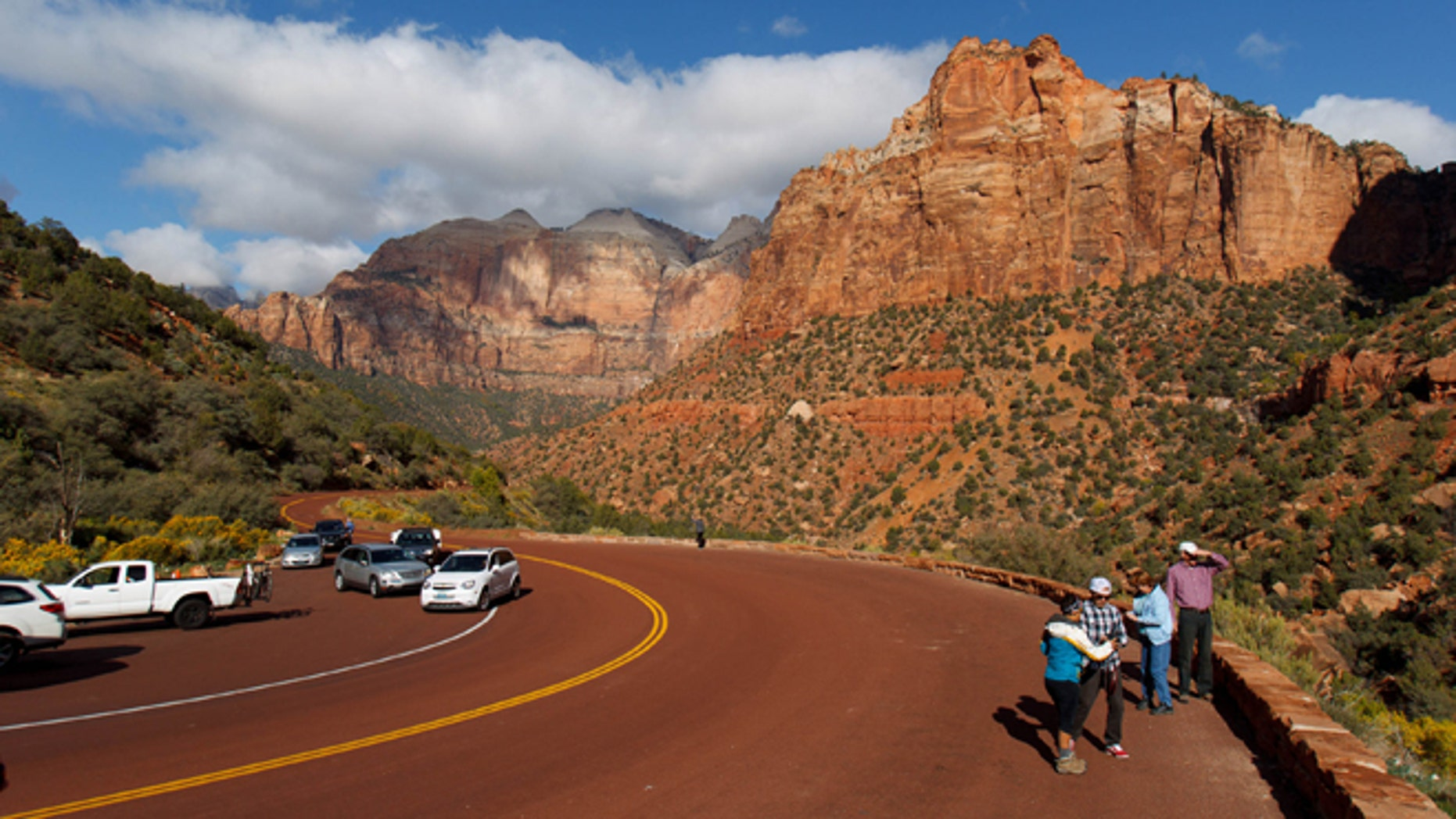 Oct. 11, 2013: Visitors to Zion National Park take in the sights after the park opened on a limited basis Friday near Springdale, Utah.