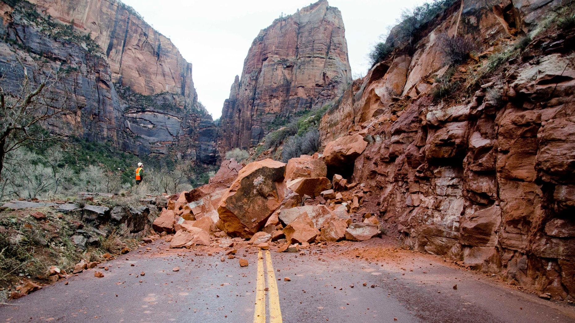 In this Saturday, Jan. 14, 2017, photo released by the National Park Service shows the Zion Scenic Drive closed just north of the Zion Lodge at Zion National Park, Utah.