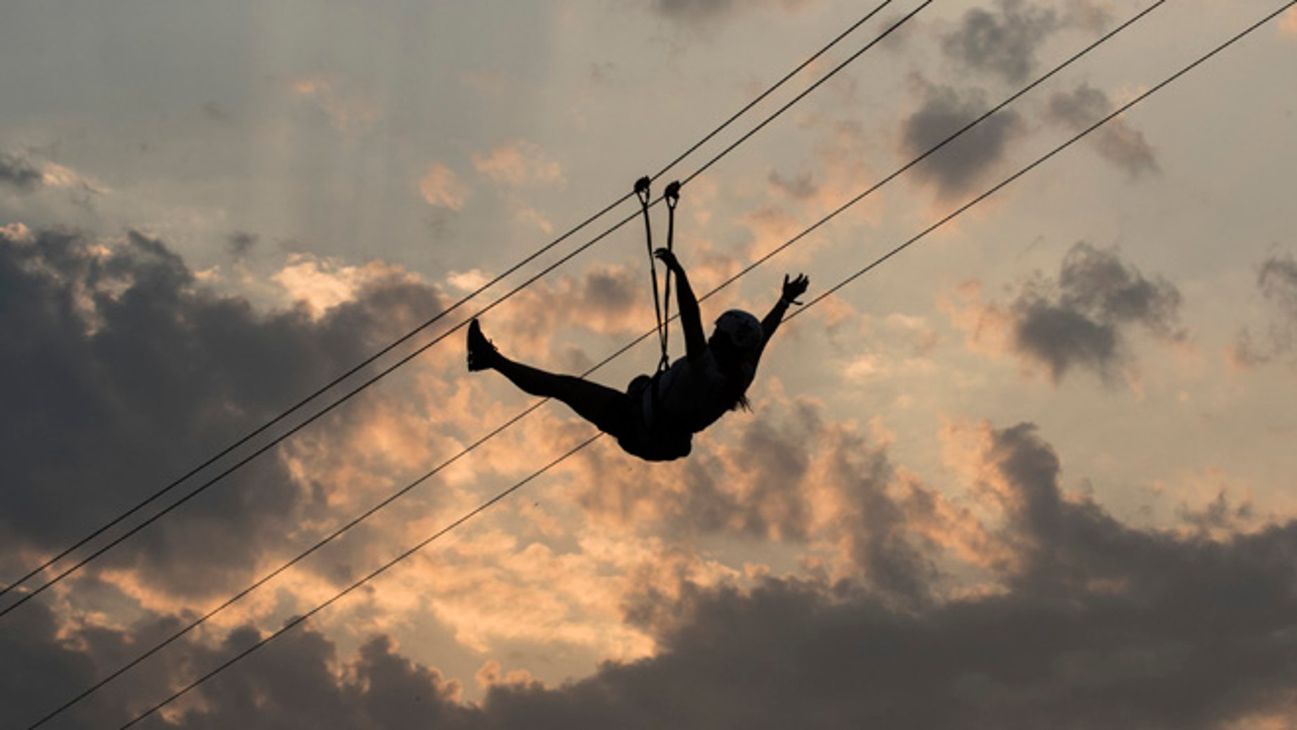 RIO DE JANEIRO, BRAZIL - SEPTEMBER 25: General atmosphere. Fans enjoying the zip-line at day 05 of 2015 Rock in Rio on September 25, 2015 in Rio de Janeiro, Brazil. (Photo by Raphael Dias/Getty Images)