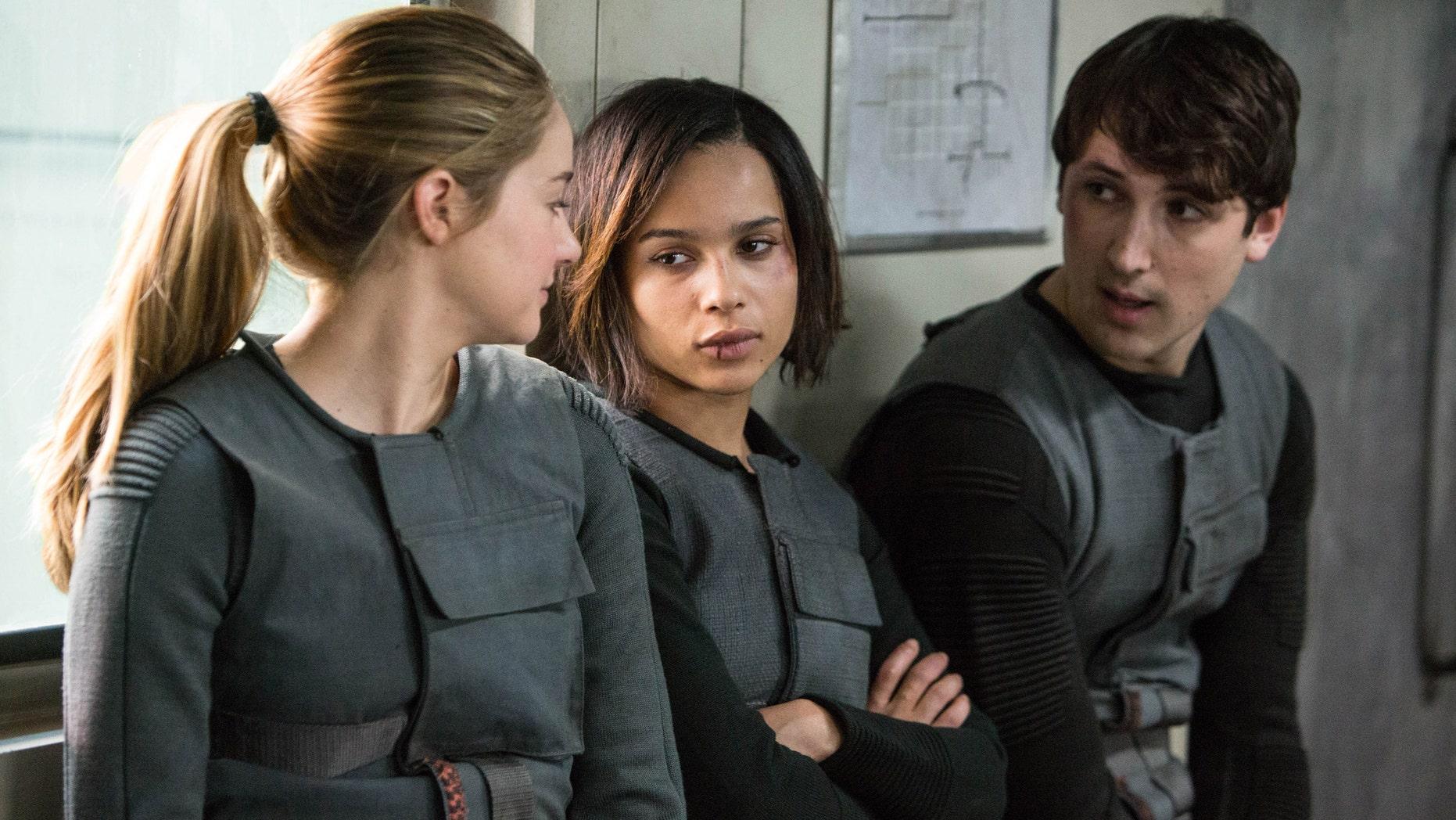 "Shailene Woodley, Zoe Kravitz, and Ben Lloyd-Hughes in a scene from ""Divergent."""