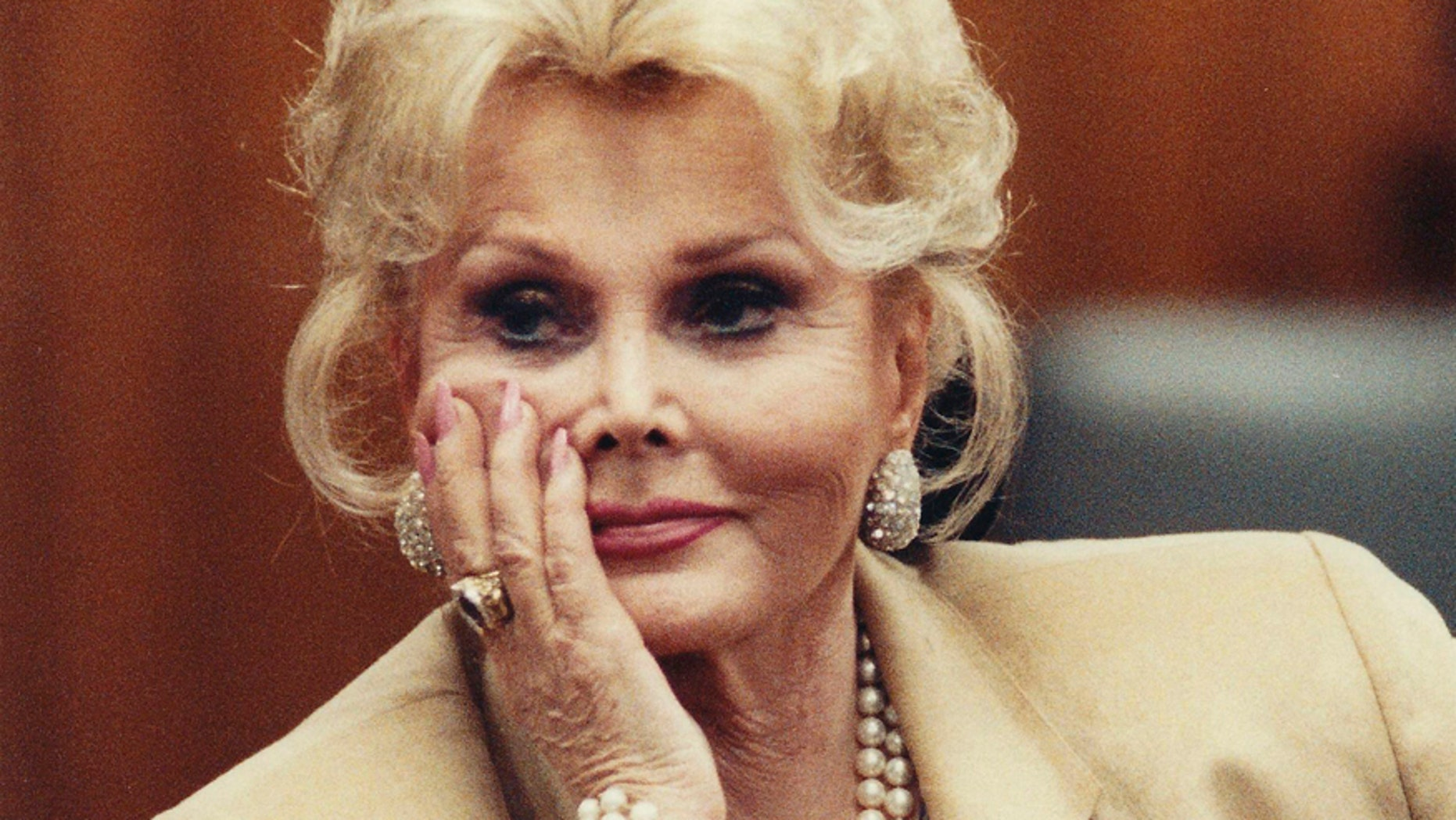 Zsa Zsa Gabor listens in court in Beverly Hills in this May 1, 1990 file photograph.  REUTERS