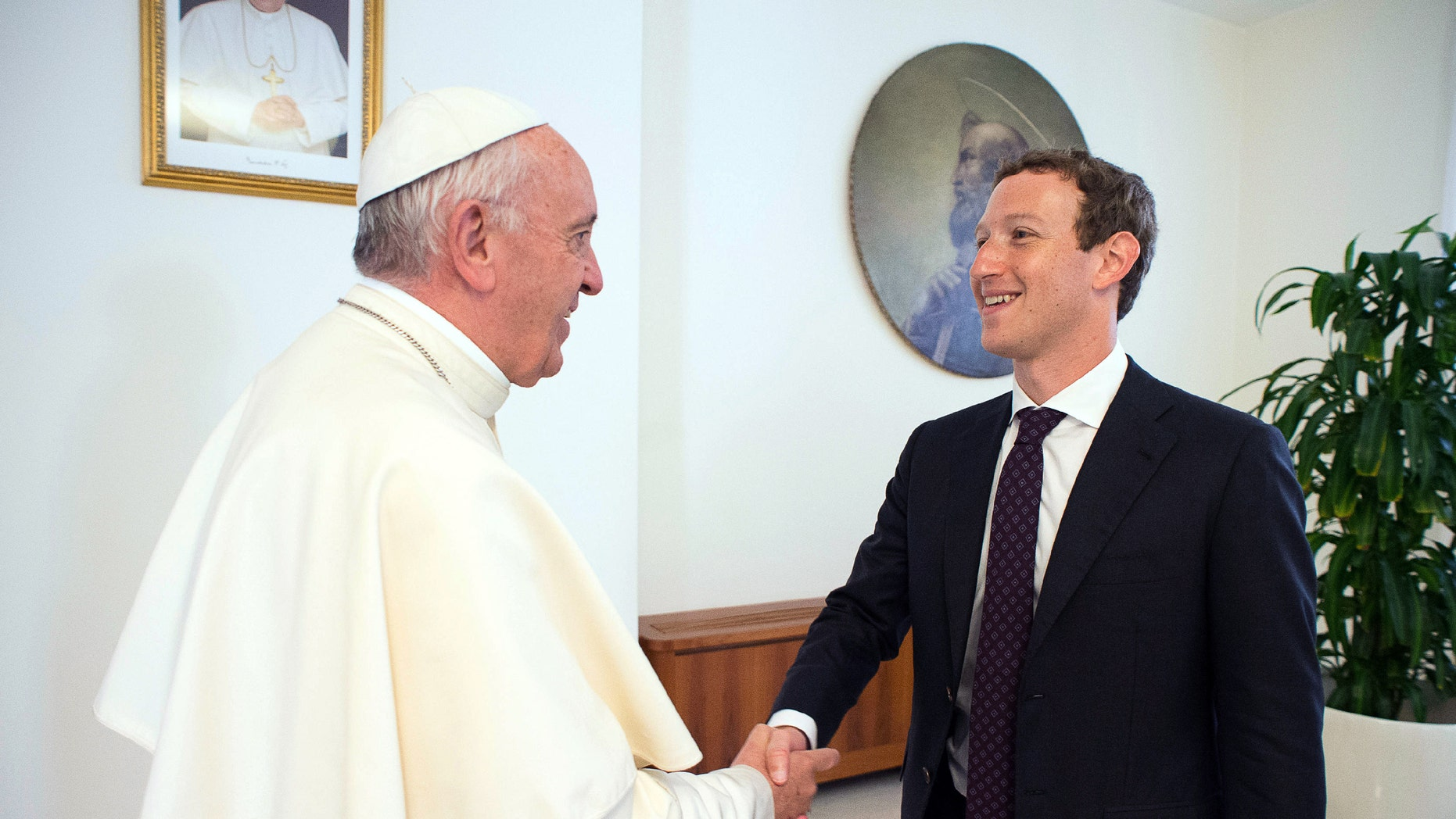 Pope Francis meets Facebook founder and CEO Mark Zuckerberg, at the Santa Marta residence, the guest house in Vatican City where the pope lives, Monday, Aug. 29, 2016. (L'Osservatore Romano/Pool Photo via AP)